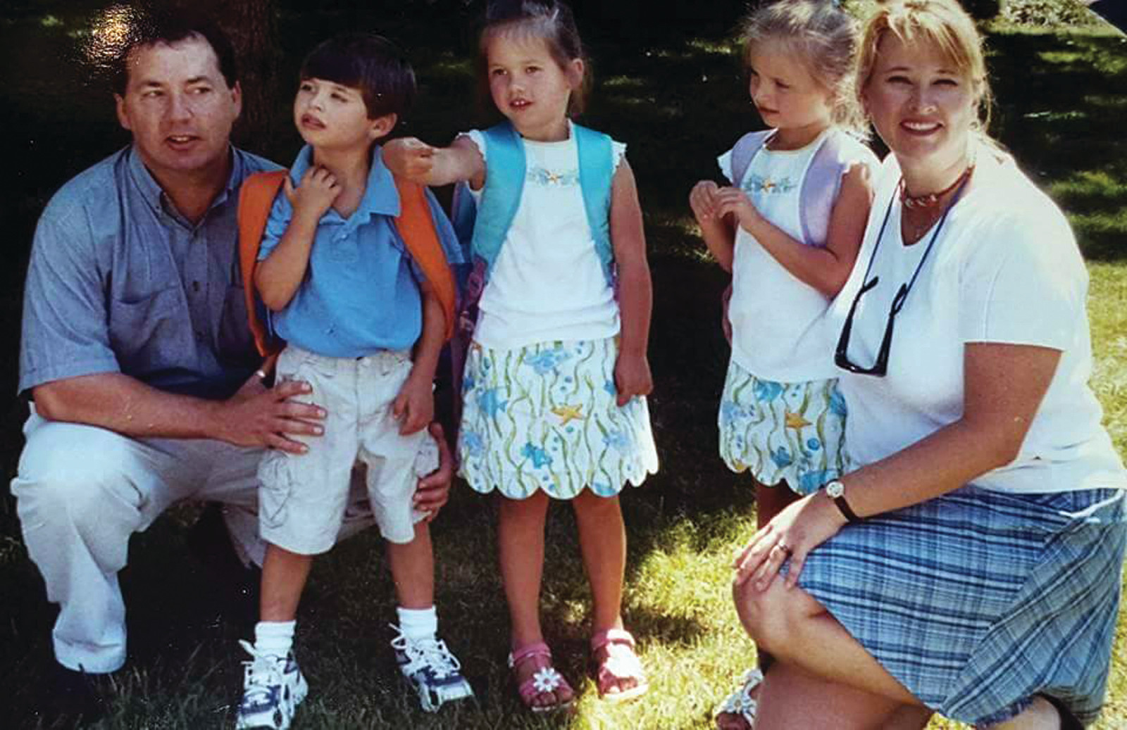 A BLUR: At left, Steve and Sue Marchetti pose proudly with their children, Ryan, Jordan and Allison as they head off to their first day of school.