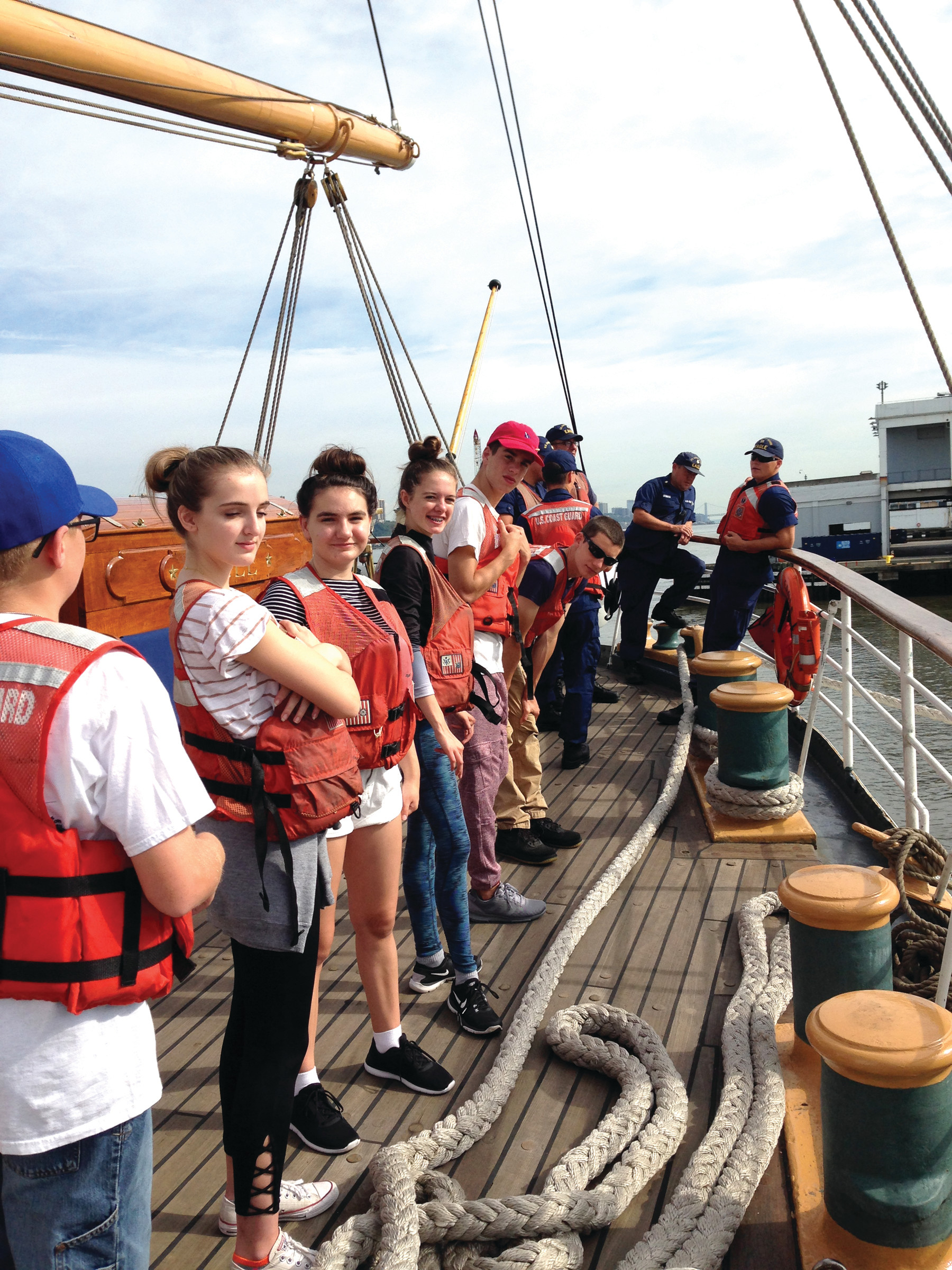 Gold Star Teens prepare for line handling duties aboard the Cutter Eagle.