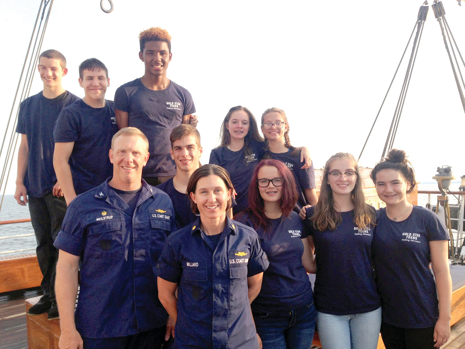 Gold Star Teens with their captain and XO aboard the U.S. Coast Guard Cutter Eagle.