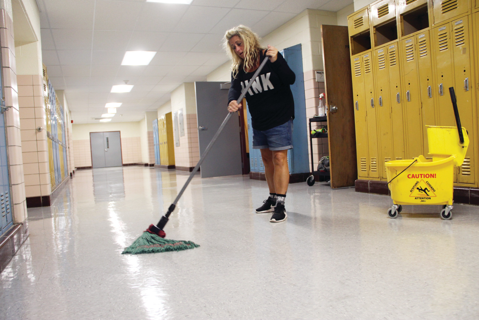 SHINING SCHOOLS: Denise Amirault puts the shine on the Vets' corridors. Ceiling tiles and lights have been replaced at the school.
