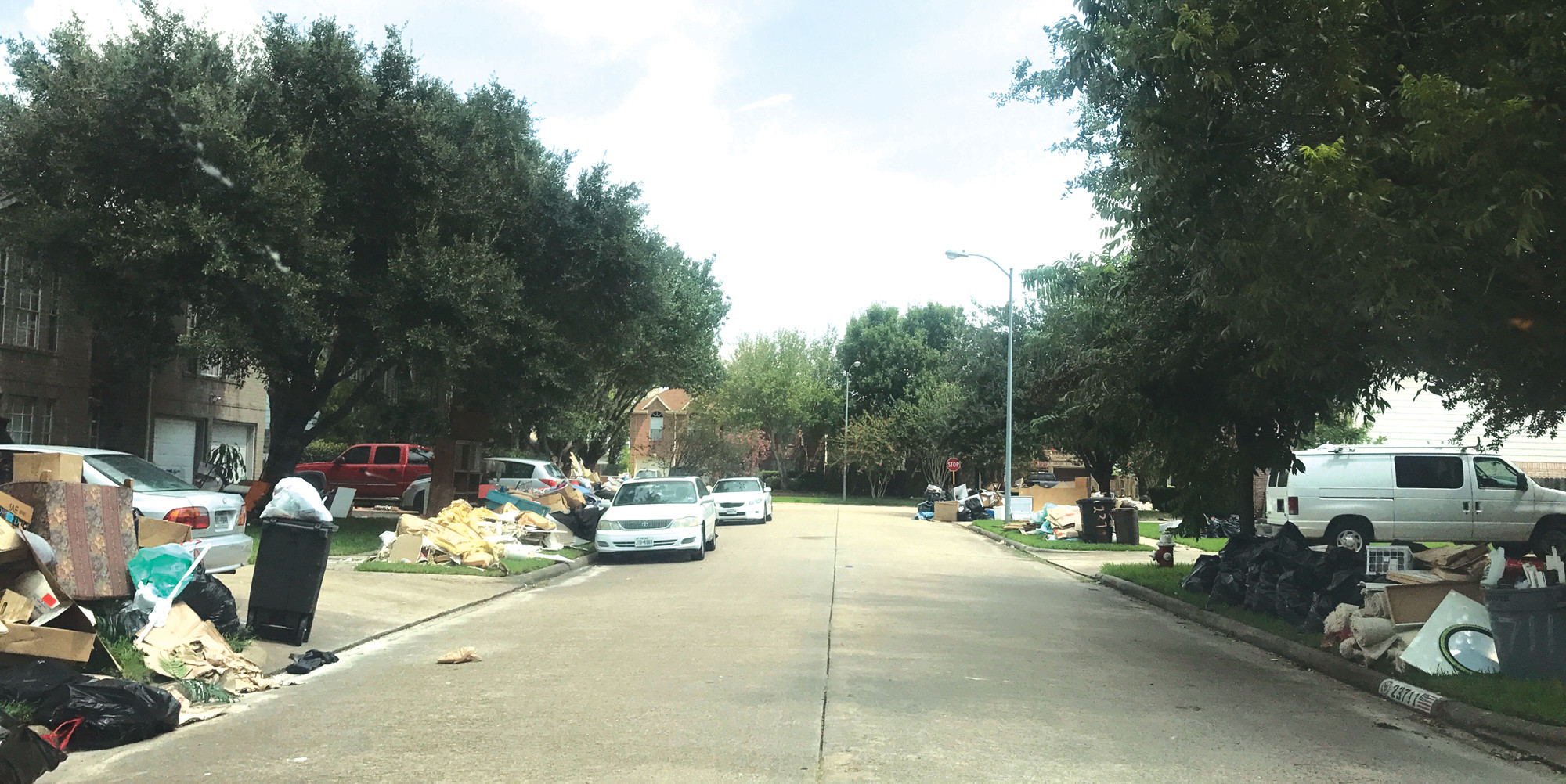 A COMMON SIGHT: Street after street features homes with debris scattered on the sidewalk, according to Robinson.
