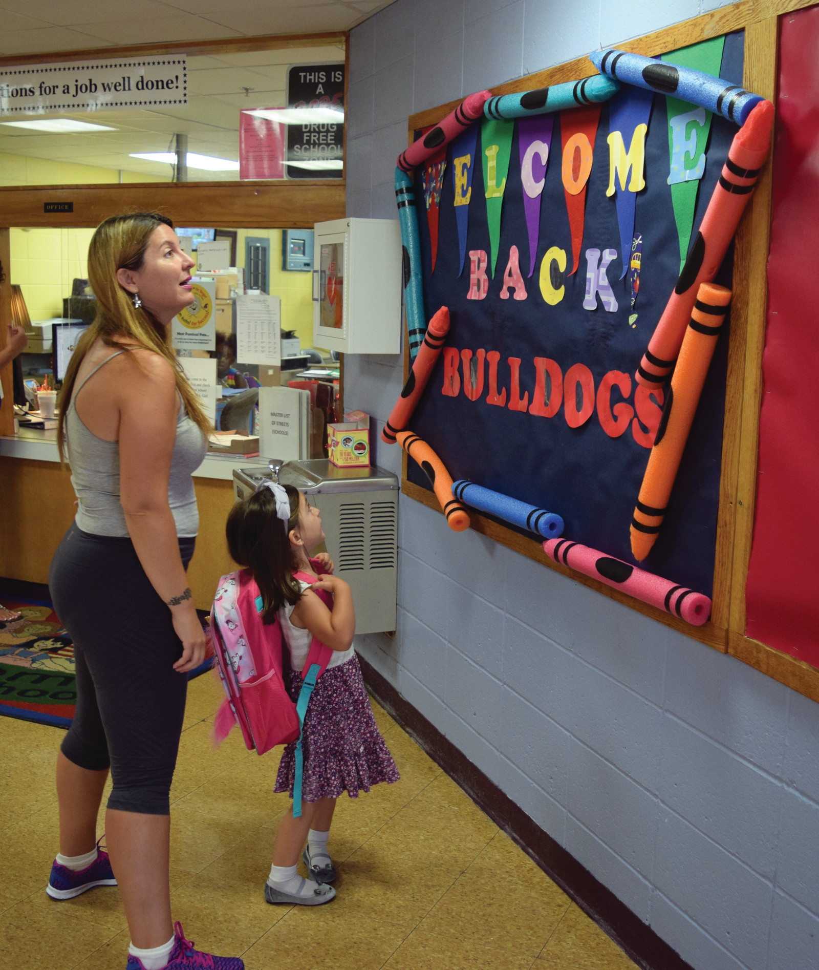 ADMIRING THE DECORATIONS: Students at Edgewood Highland were welcomed back in style.