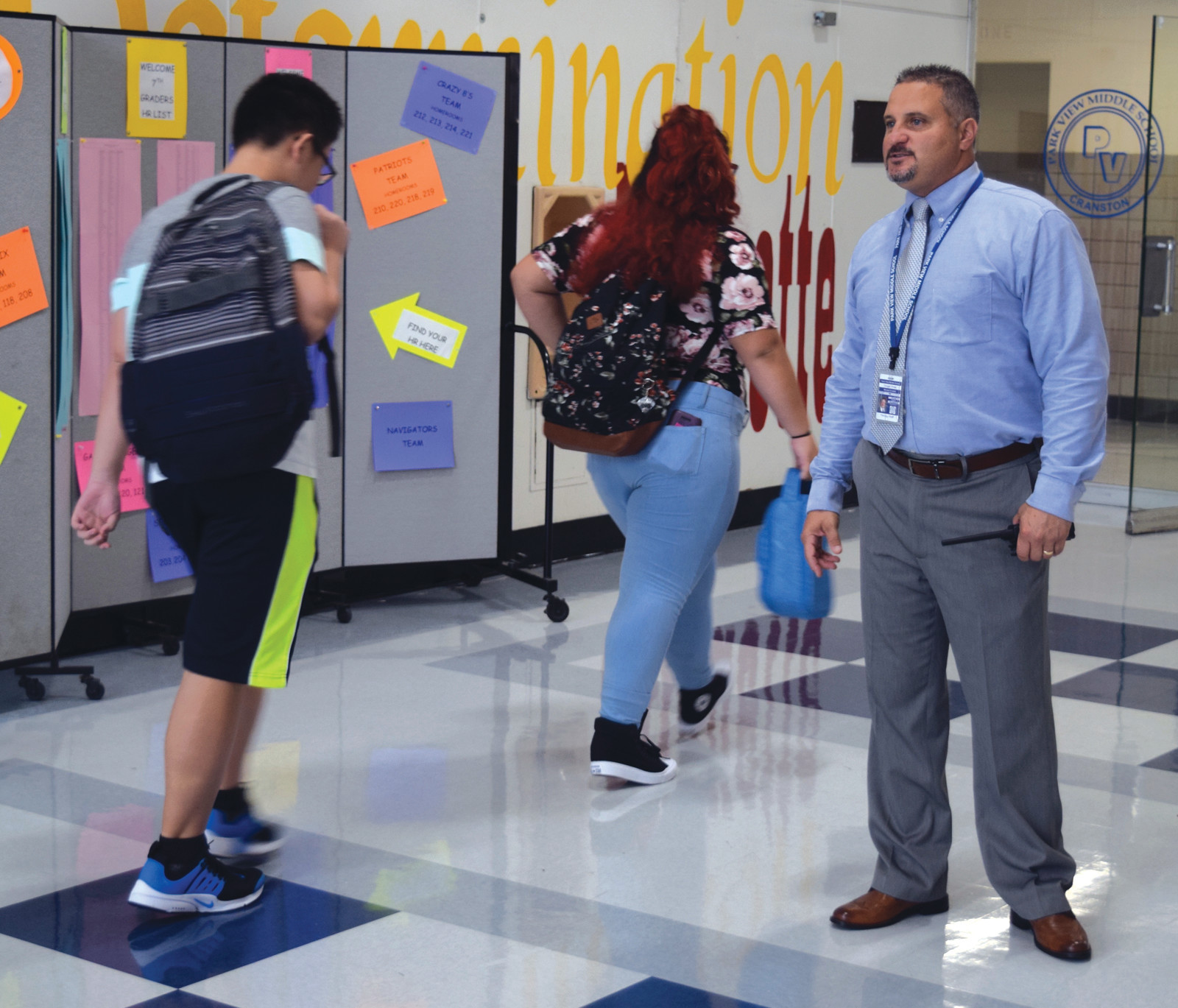 HELPING WITH DIRECTIONS: Park View Principal Mike Crudele helped students with where to go.