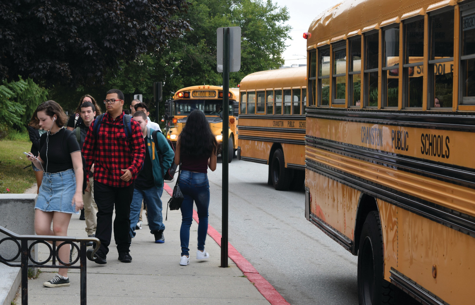 BOLTING TO CLASS: Busloads of Cranston East students were back to school bright and early to kick off the new year.
