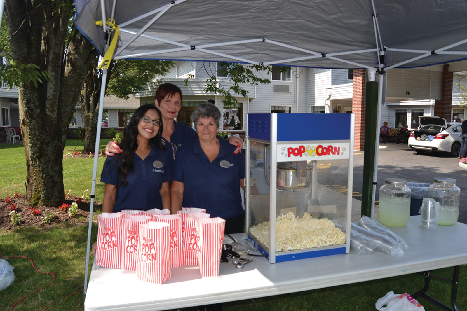 READY TO SERVE: Pocasset Bay employees were on hand to provide popcorn and lemonade to the day's visitors.