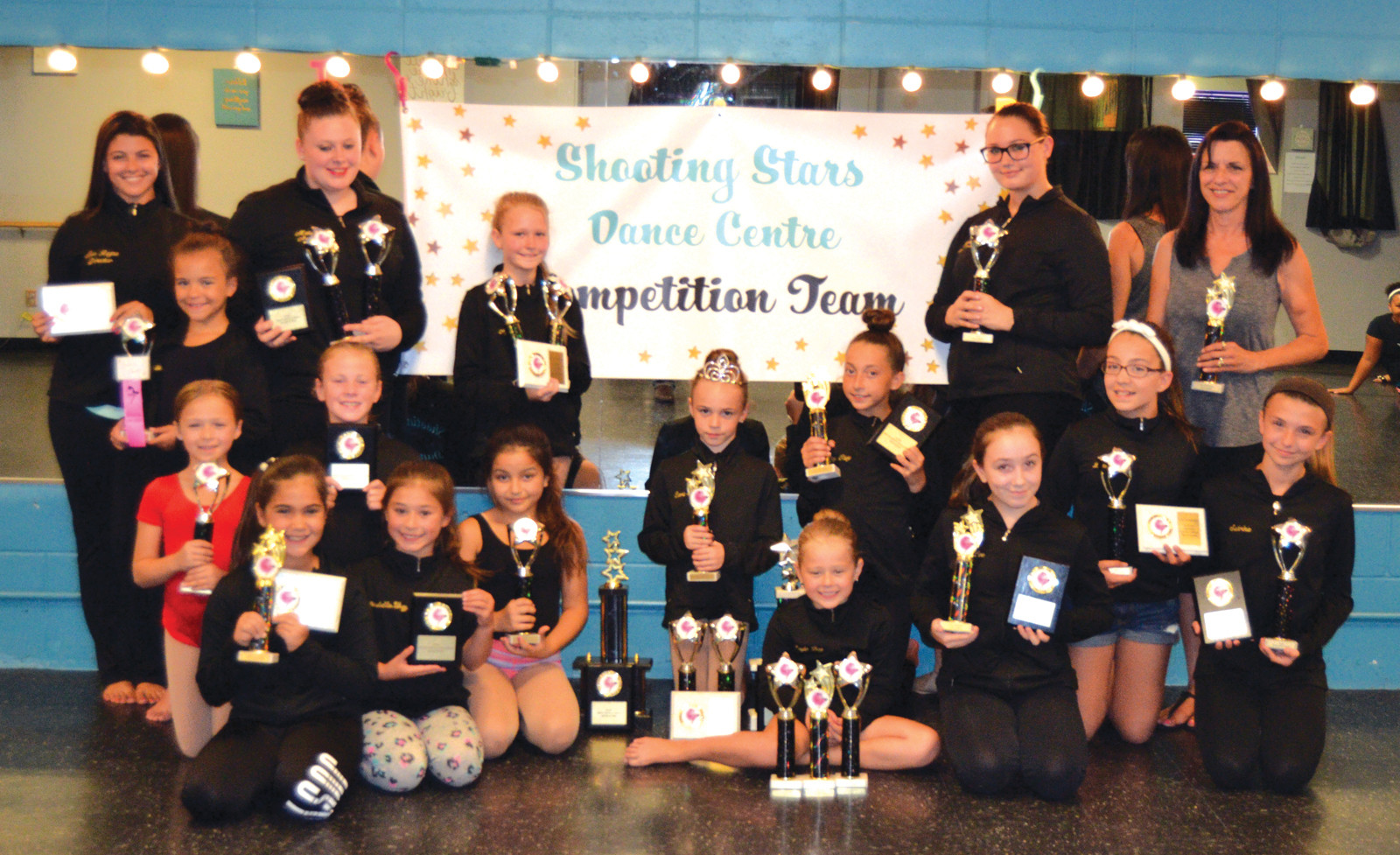 PROUD PERFORMERS: The Shooting Stars Dance Center competition team features co-owner Rayna D'Amico, Kenzi Cartier, Isabella Alvarez, Alyson Brown, Cora Tully, Laya Tully, kassidy Disano, lele Rivars, Sabrina smith, Lauren Depot, Cheyann Hazard, Analeah Martins, Ella Annicelli, Arabella Valiente, Giuliana Shanley, Natalie Toj and co-owner Pat D'Amico. (Sun Rise photos by Tim Forsberg)