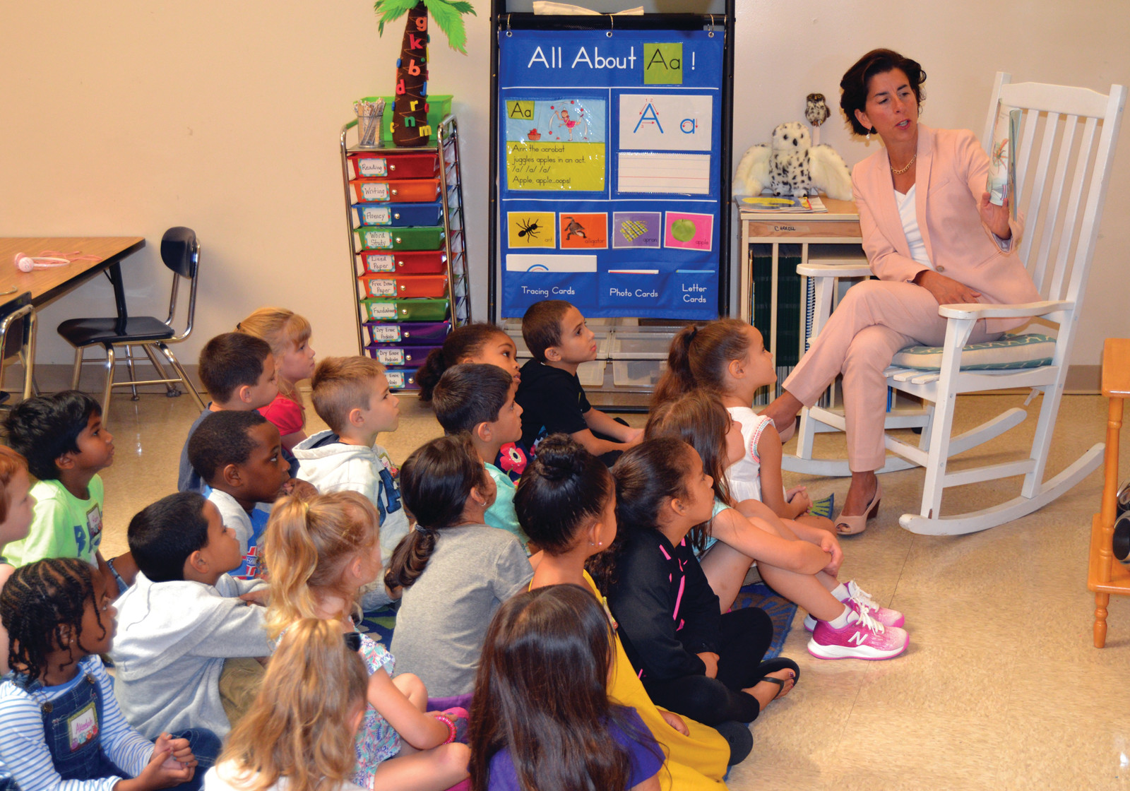 "STORY TIME: Gov. Gina Raimondo read ""Clark the Shark"" to the children of Miss Carroll's class during her visit on Tuesday."