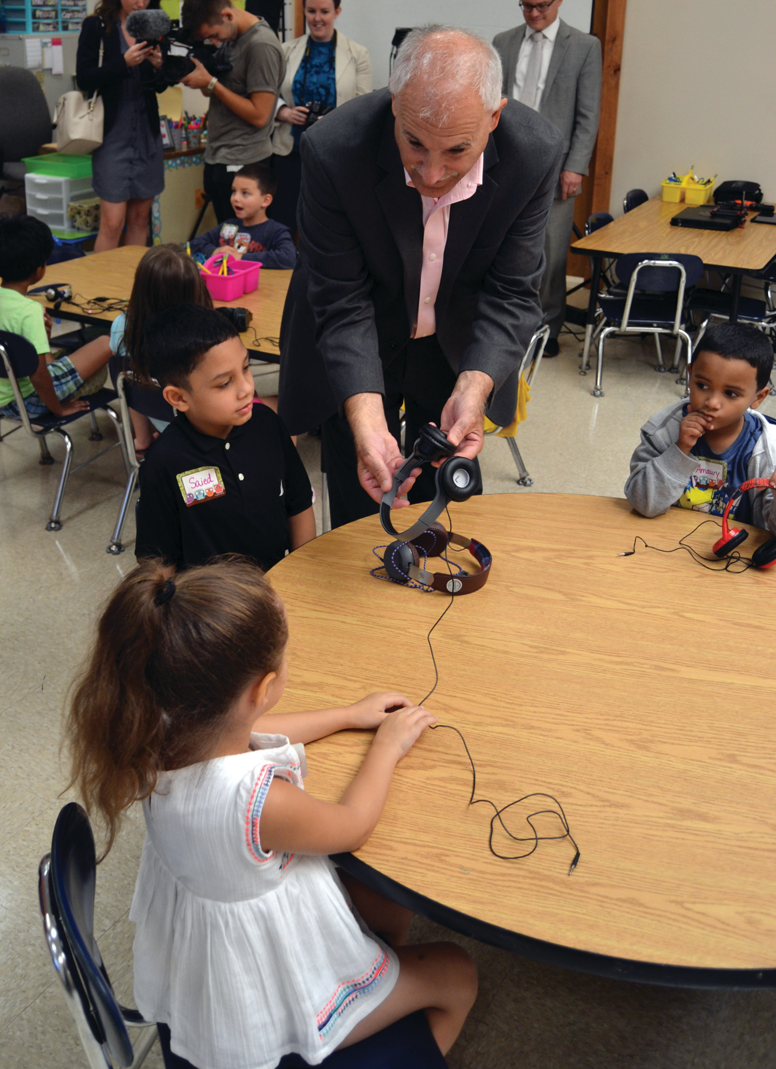 CAN YOU HEAR ME? Mayor Joseph Polisena enjoyed the wide variety of stylish headphones that the students would wear while using Chromebooks.