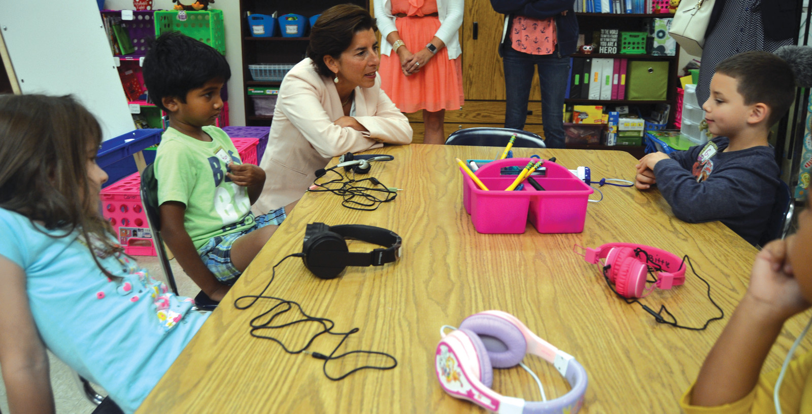 HOLDING COURT: Gov. Raimondo talks with kindergarteners and discusses what they like about school.