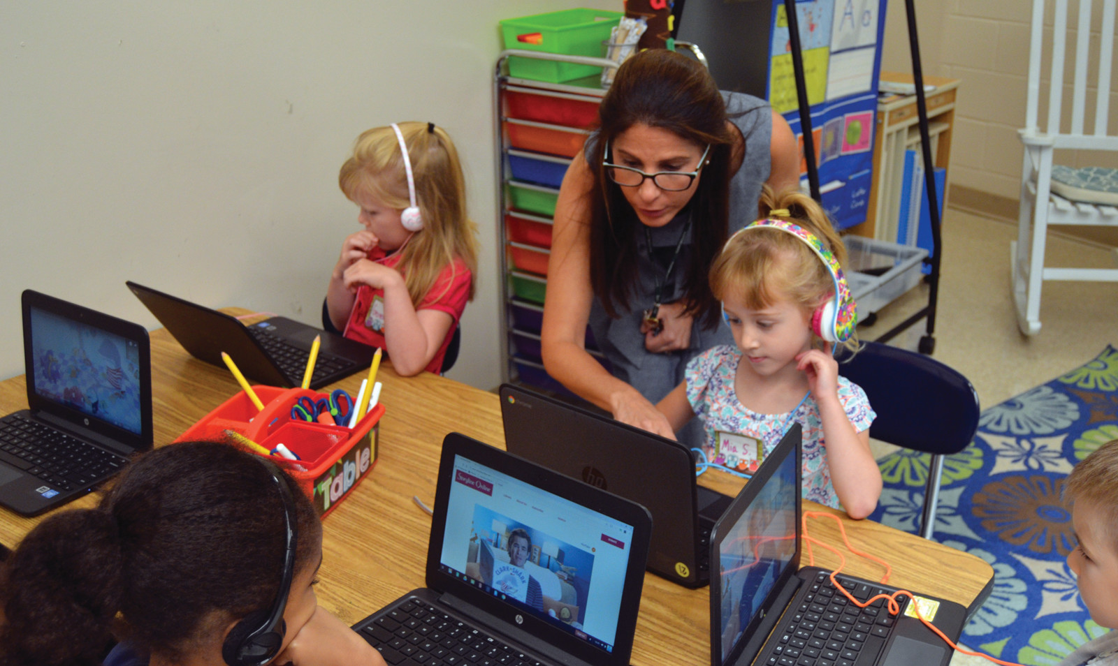 PROUD PRINCIPAL: ECC Principal Julie-anne Zarrella helps a student navigate on her new device Tuesday morning.