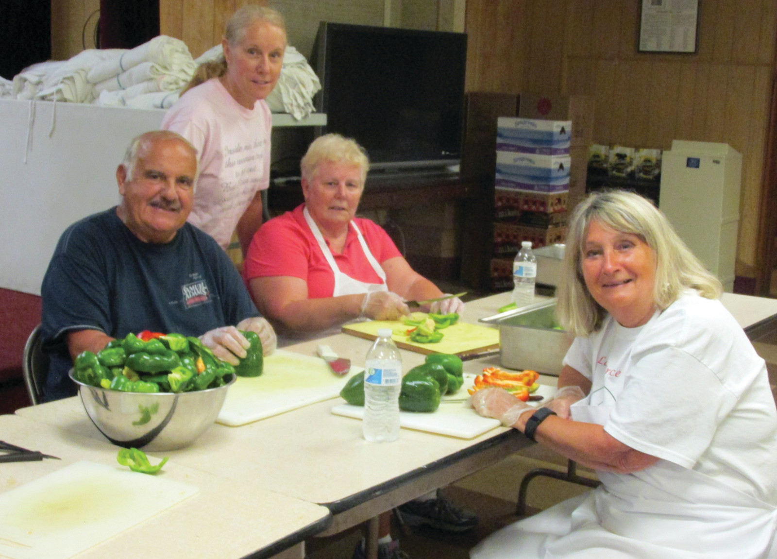"SUPER STAFFERS:  Anna Bucci (left), who is also known as ""Macaroni and Meatball Annie"" and Chef Carol Cambio are joined by Joe Quartino, co-chairman of the Our Lady of Grace Feast and Festival that opens tonight at 5 o'clock and runs through Sunday evening until 9 p.m."
