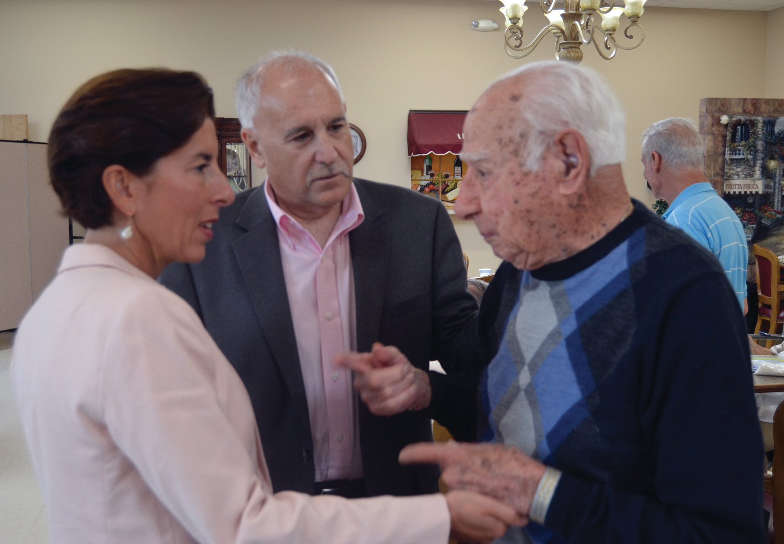 CENTENARIAN SURPRISE: 102-year-old Johnstonian Orlando Ricci took a moment to greet the Governor during her visit to the senior center.