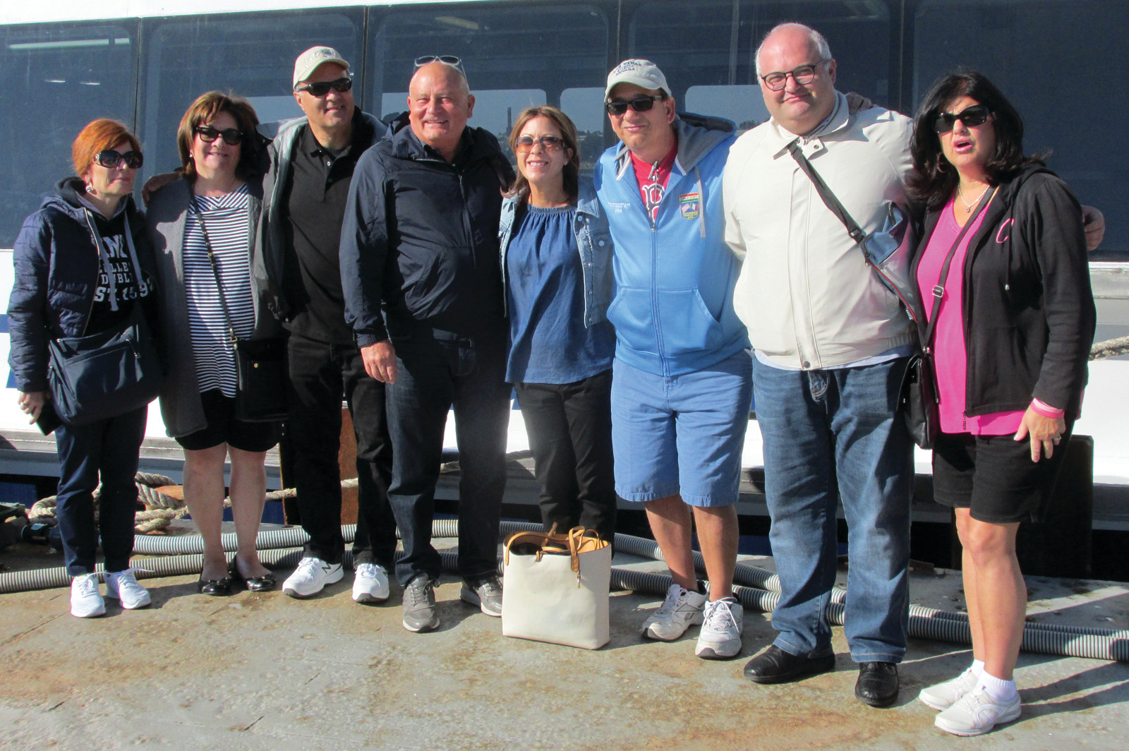 GRAND GUESTS: Lou and Susan Mansolillo, who hosted an old-fashioned New England Clam Bake Monday at their home in Johnston, are joined by school and church officials from Panni Foggia, Italy at the dock in Providence prior to Saturday's tour in Newport.