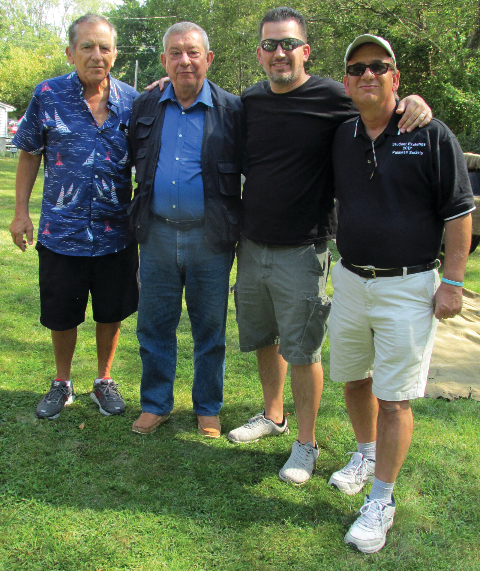 PANNESE PEOPLE: Lou Spremulli (right), Vice President of Pannese Society, is joined by fellow members Arthur and David Venditelli who welcome Renato Mansolillo from Panni Foggia Italy to Monday's special outing in Johnston.