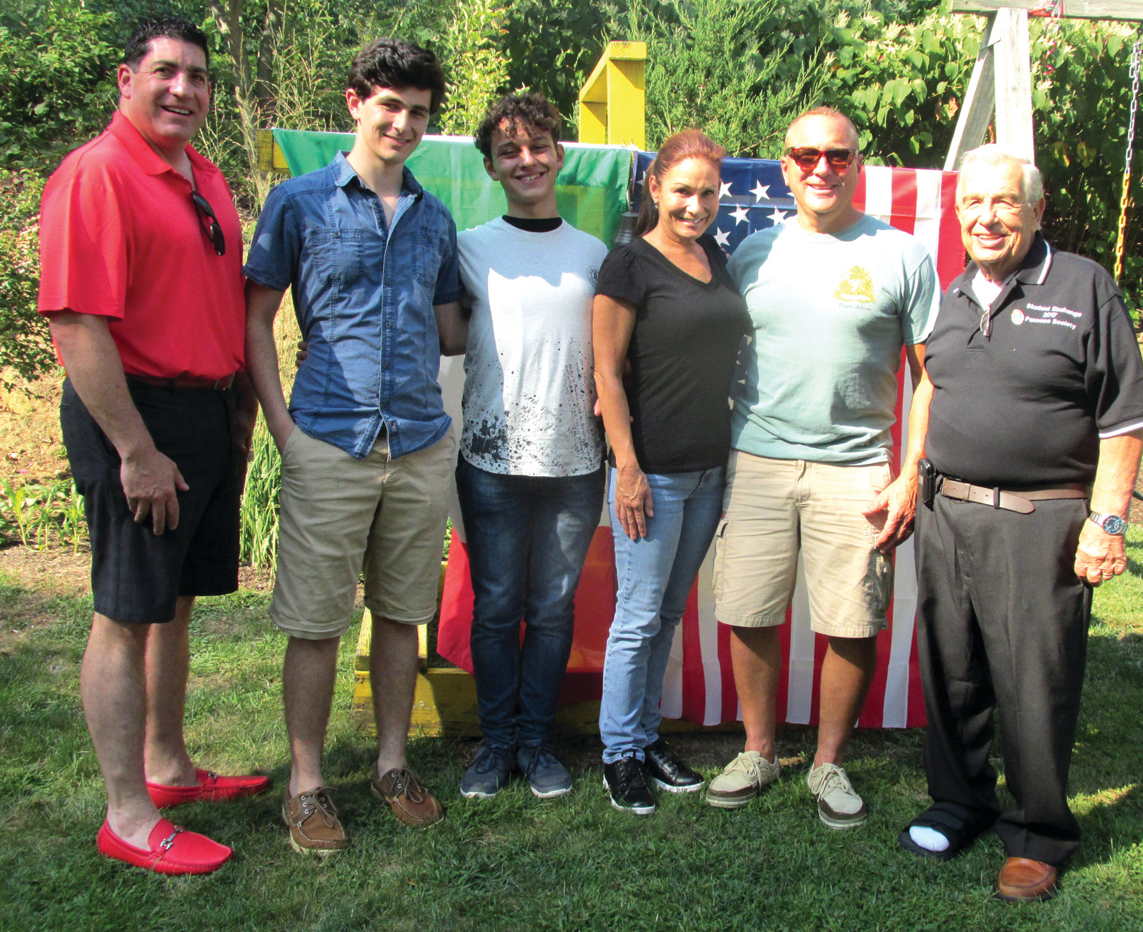 "HAPPY HOSTS: Johnston State Rep. Stephen Ucci (left) served as special host for guests from Panni Foggia, Italy during Monday's clambake at the home of his sister Susan Mansolillo and is joined by the Mollicone family who has opened their home to ""Jerry"" Francavilla from Italy."