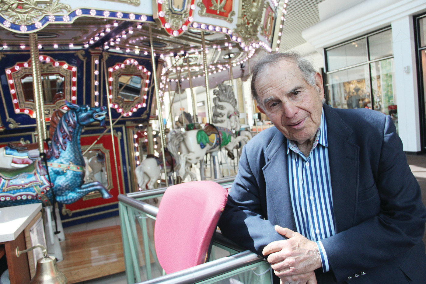HIS IDEA: Aram Garabedian, managing partner of Warwick Mall, beside the carousel he insisted be a part of the mall.
