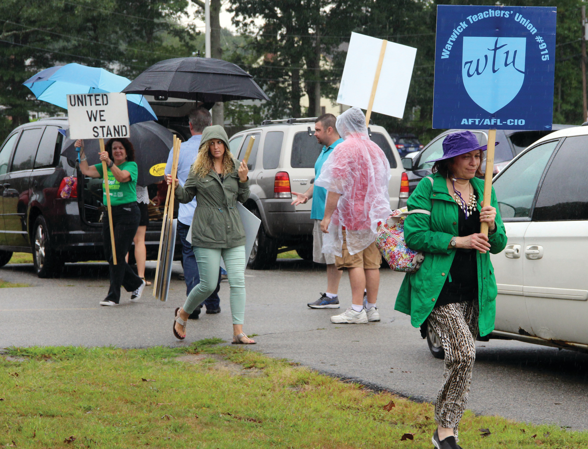 DEMANDS UNDERLINED: The Warwick Teacher's Union has reiterated their unhappiness with the school committee as they enter a third year without a teaching contract. Union president Darlene Netcoh said that a strike was not out of the question. Here, teachers picket outside of Pilgrim High School following the first full day of school.