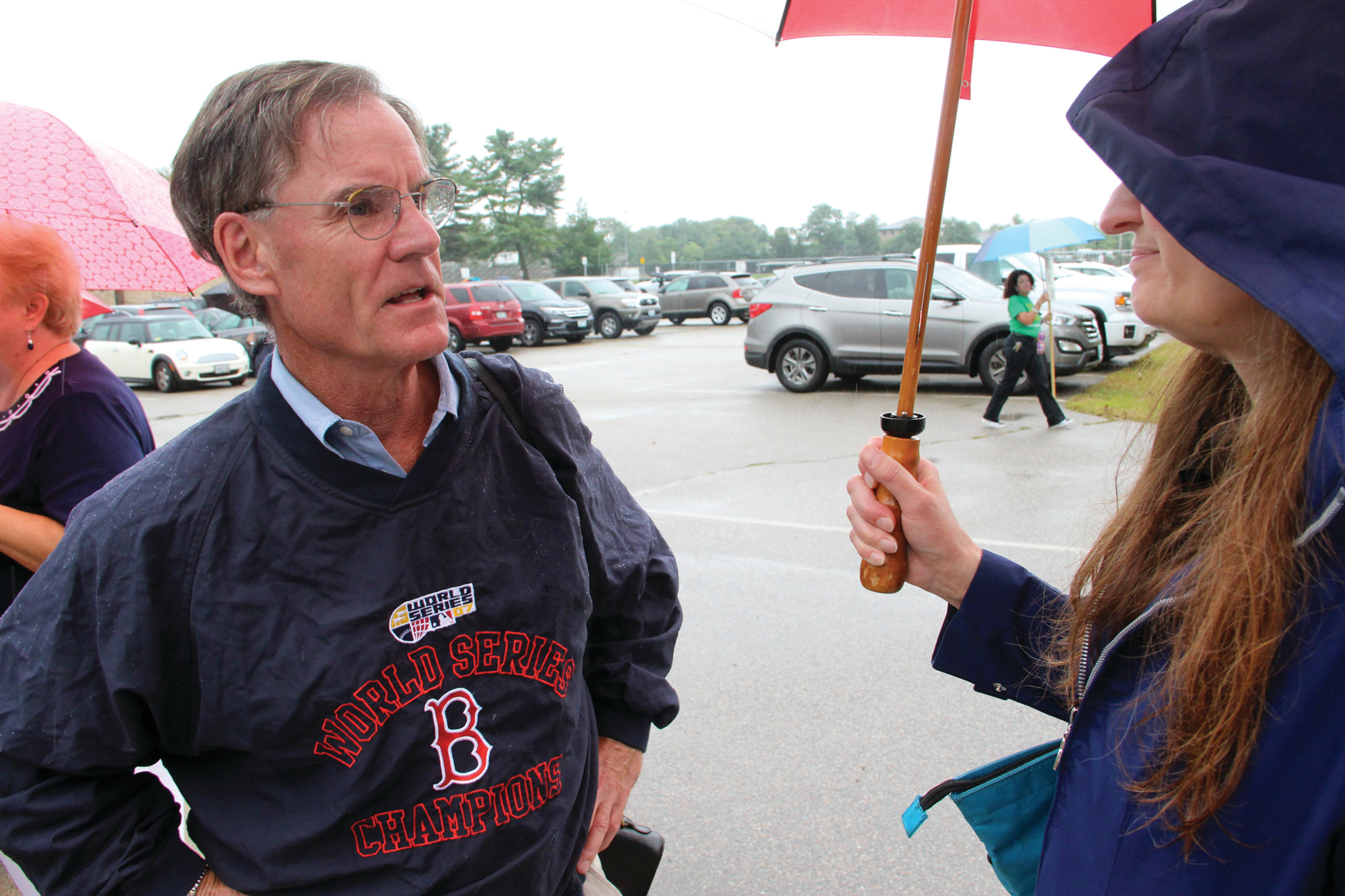 GIVING COUNSEL: Ward 1 City Councilor Richard Corley discusses with Darlene Netcoh during the informational picket outside of Pilgrim High School on Wednesday. Corley was present to attend a walkthrough of the school to assess areas of need for future renovations.