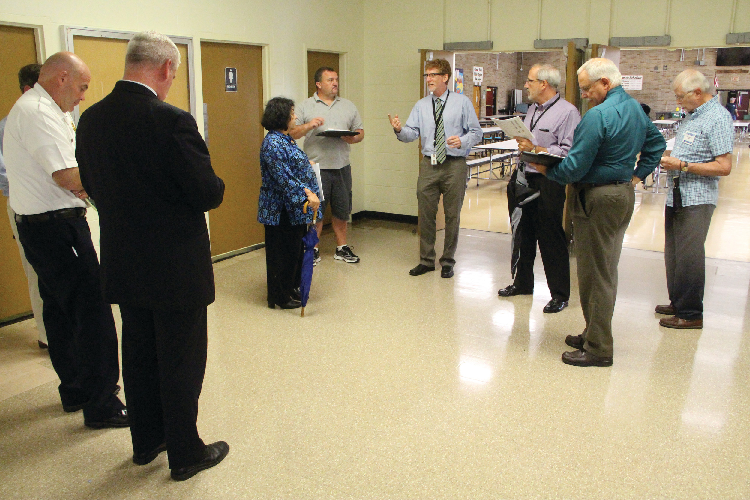 WALKABOUT: Superintendent Philip Thornton leads the group conducting a walkthrough of Pilgrim High School on Wednesday.