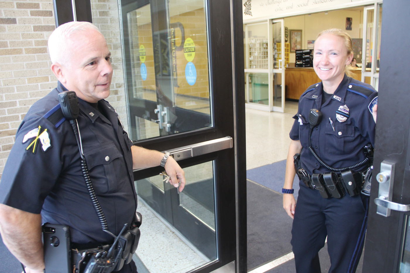 SHOWING HER THE ROPES: Dennis Amerantes, who after a 30-year career with Warwick Police and most recently as the school service officer at Pilgrim will retire in October, shows officer Jill Marshall around the building.