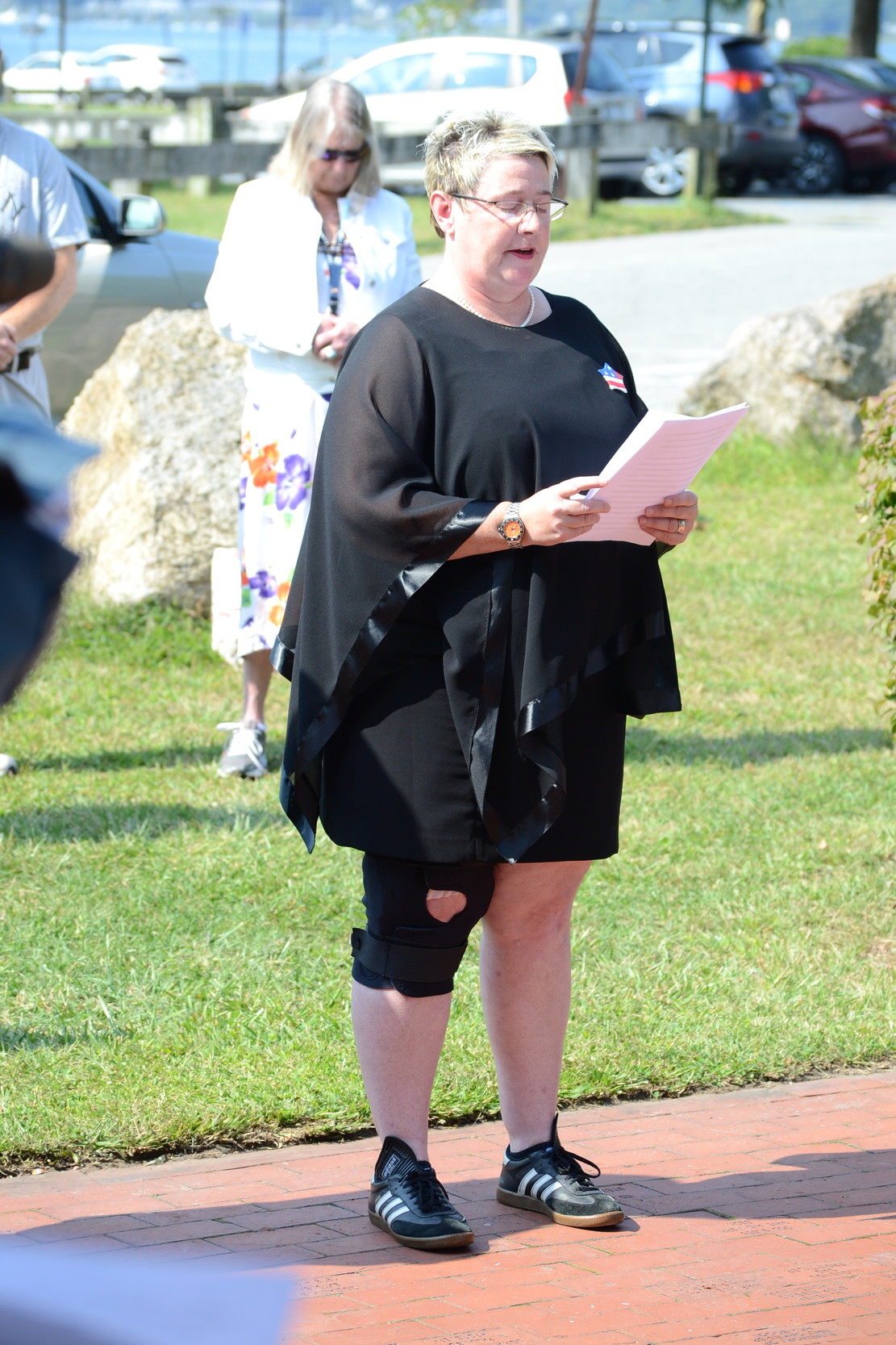 Judy Cobden, who was working at the New York Stock Exchange on Ground Zero when the attacks occurred, recounted her story at the Oakland Beach Memorial, wearing the same shoes she wore on the morning of Sept. 11, 2011.