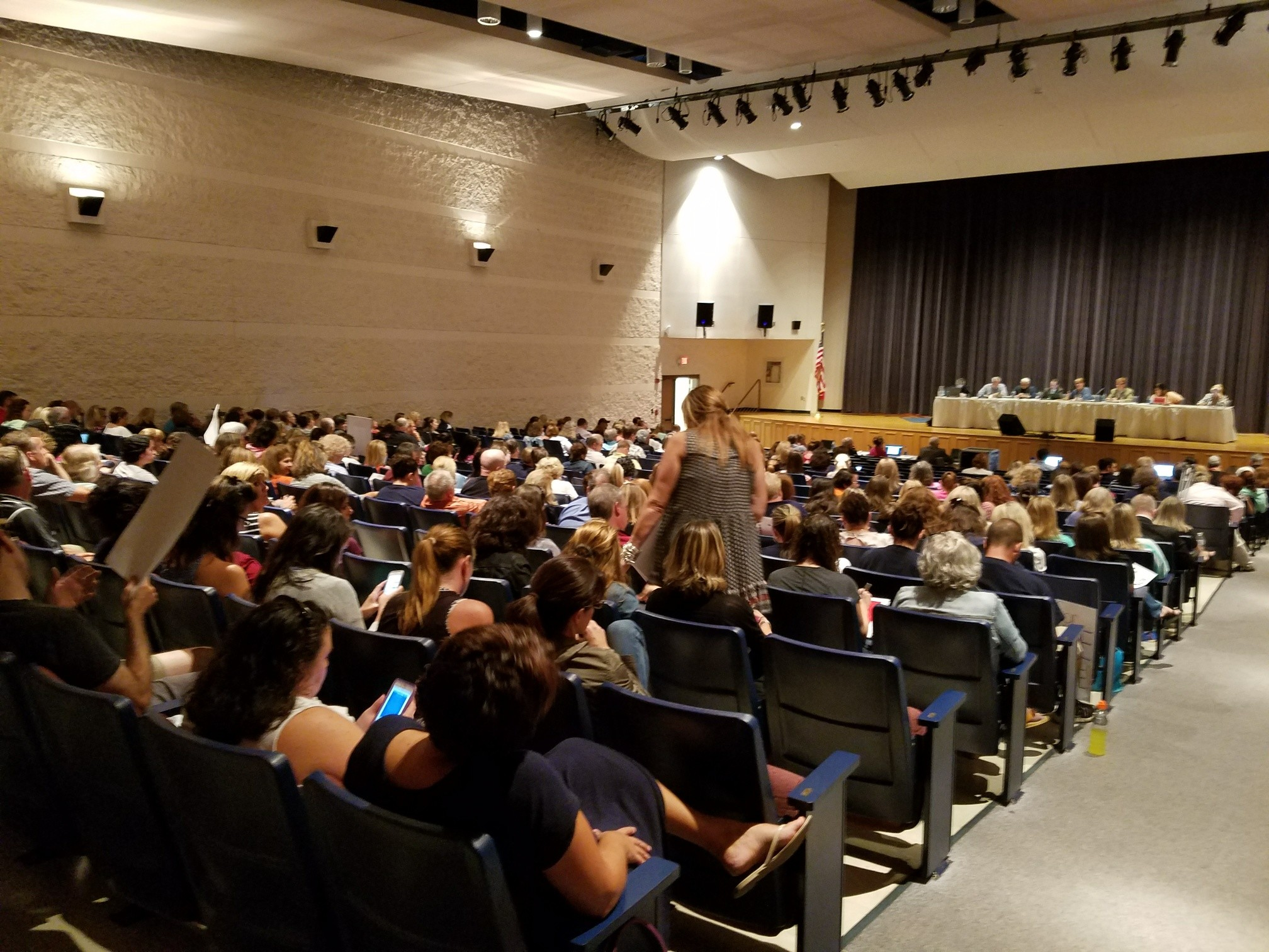 FULL HOUSE: A nearly full Toll Gate High School auditorium was the stage for a night full of emotional pleas and angry public comments.
