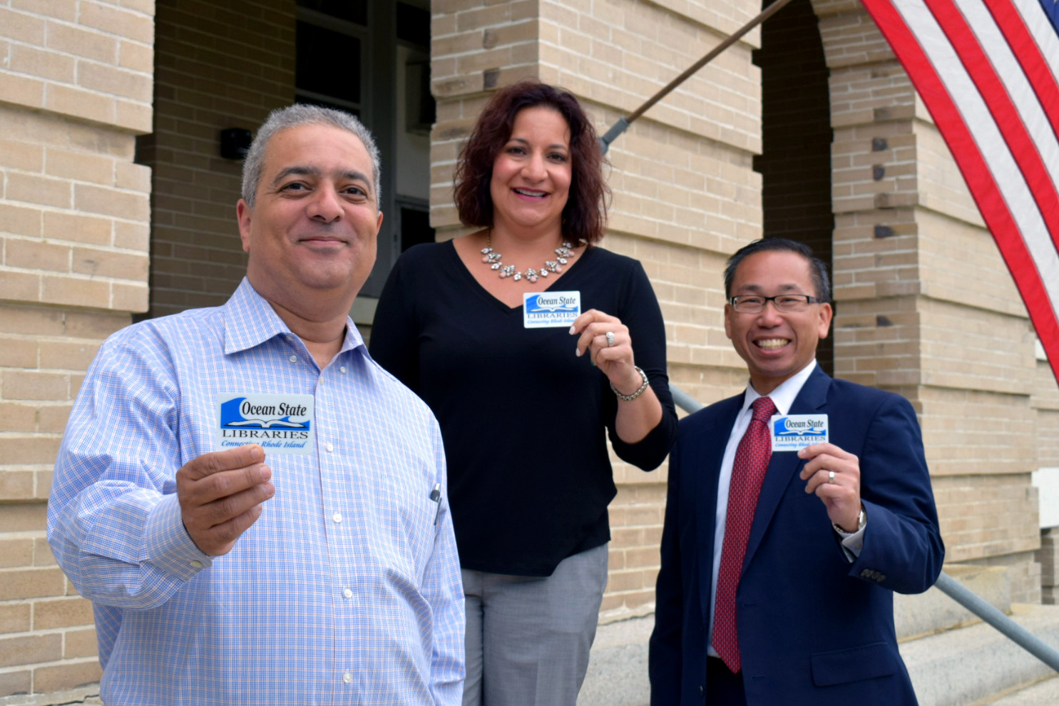 FRESH START: Pictured are Library Director Ed Garcia, Superintendent Jeannine Nota-Masse, and Mayor Allan W. Fung as they proudly present library cards to promote 'Fresh Start,' an initiative to make sure all students in Cranston have a working library card.