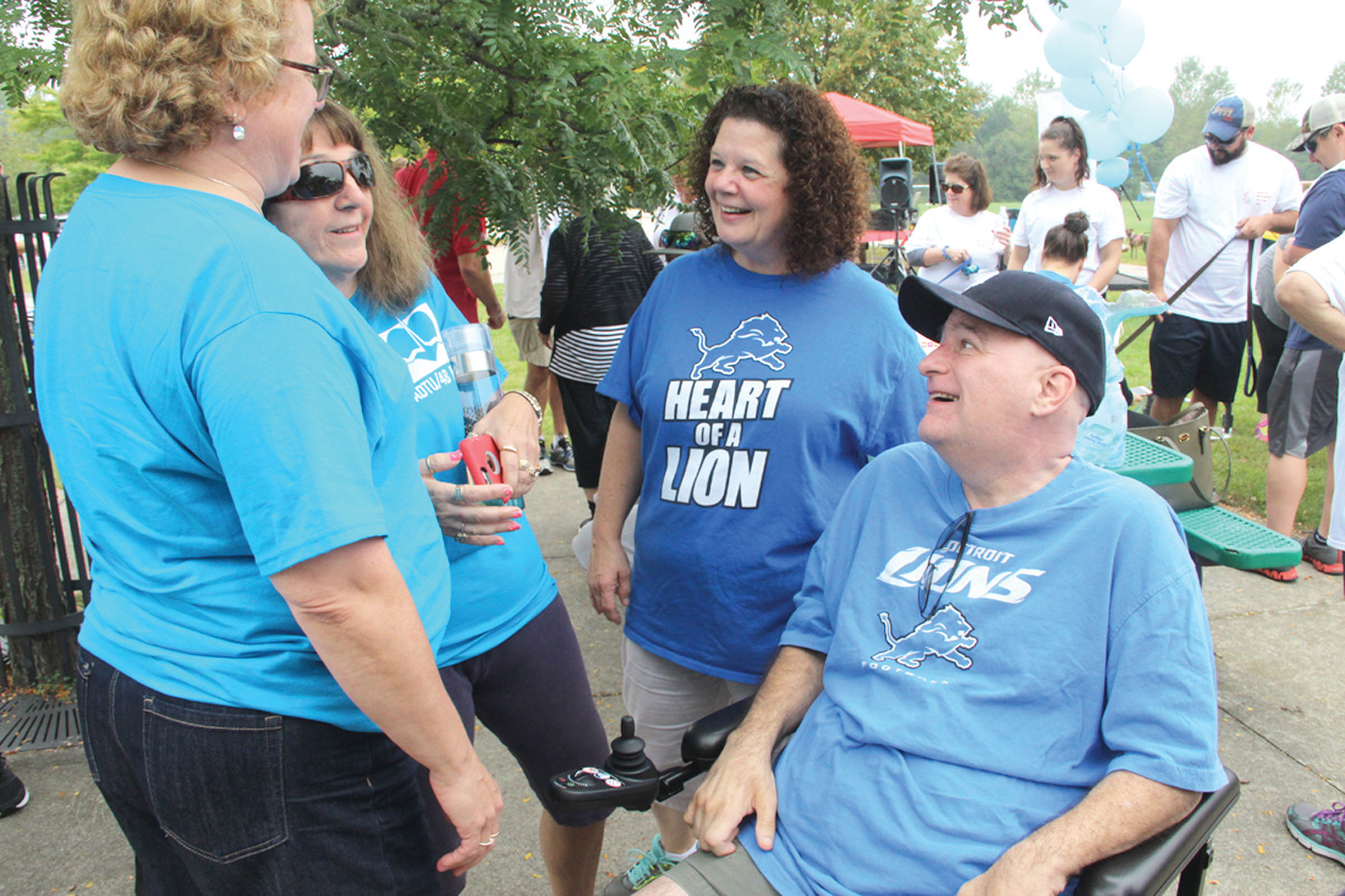 TEAM INSPIRATION: Ron Rounds of Warwick, who was diagnosed with ALS about two years ago, is joined by his wife Julie and other members of the Lion Heart team who walked the track at Conferda Sports Complex Sunday.