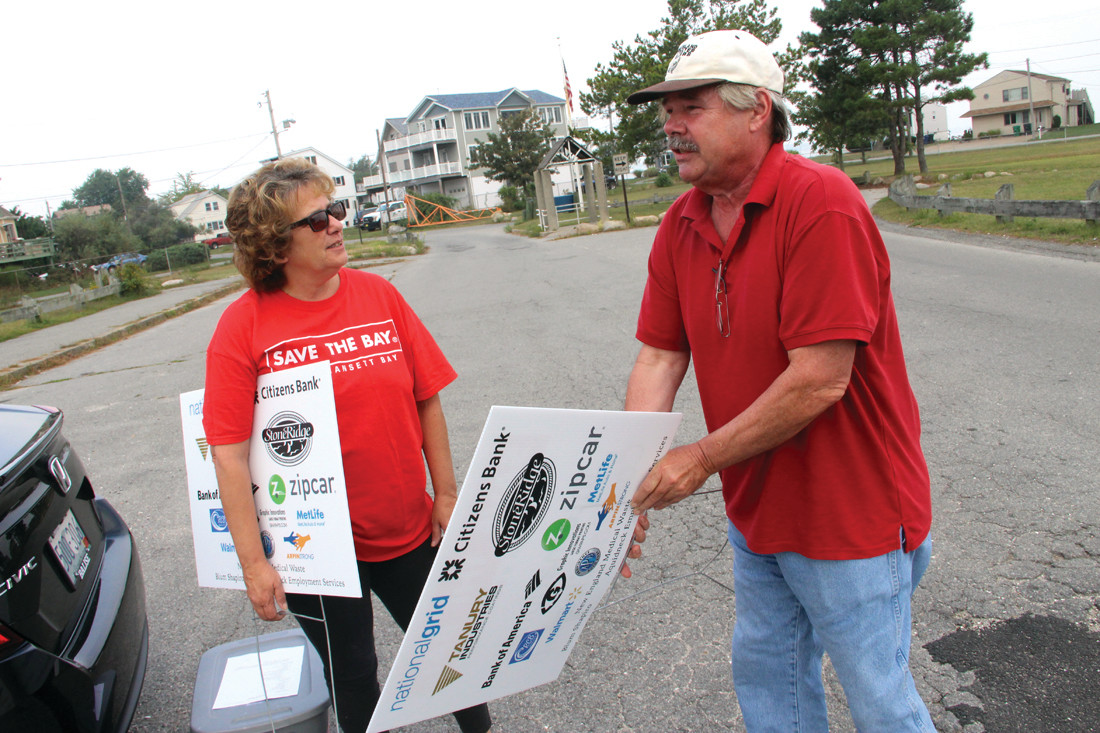 READY TO START COLLECTIONS: Deb Delmonico from Save the Bay and John Paul of the Conimicut Village Association prepare for volunteers to clean up Conimicut Point. Cress collected 84 pounds of trash not including a mattress.