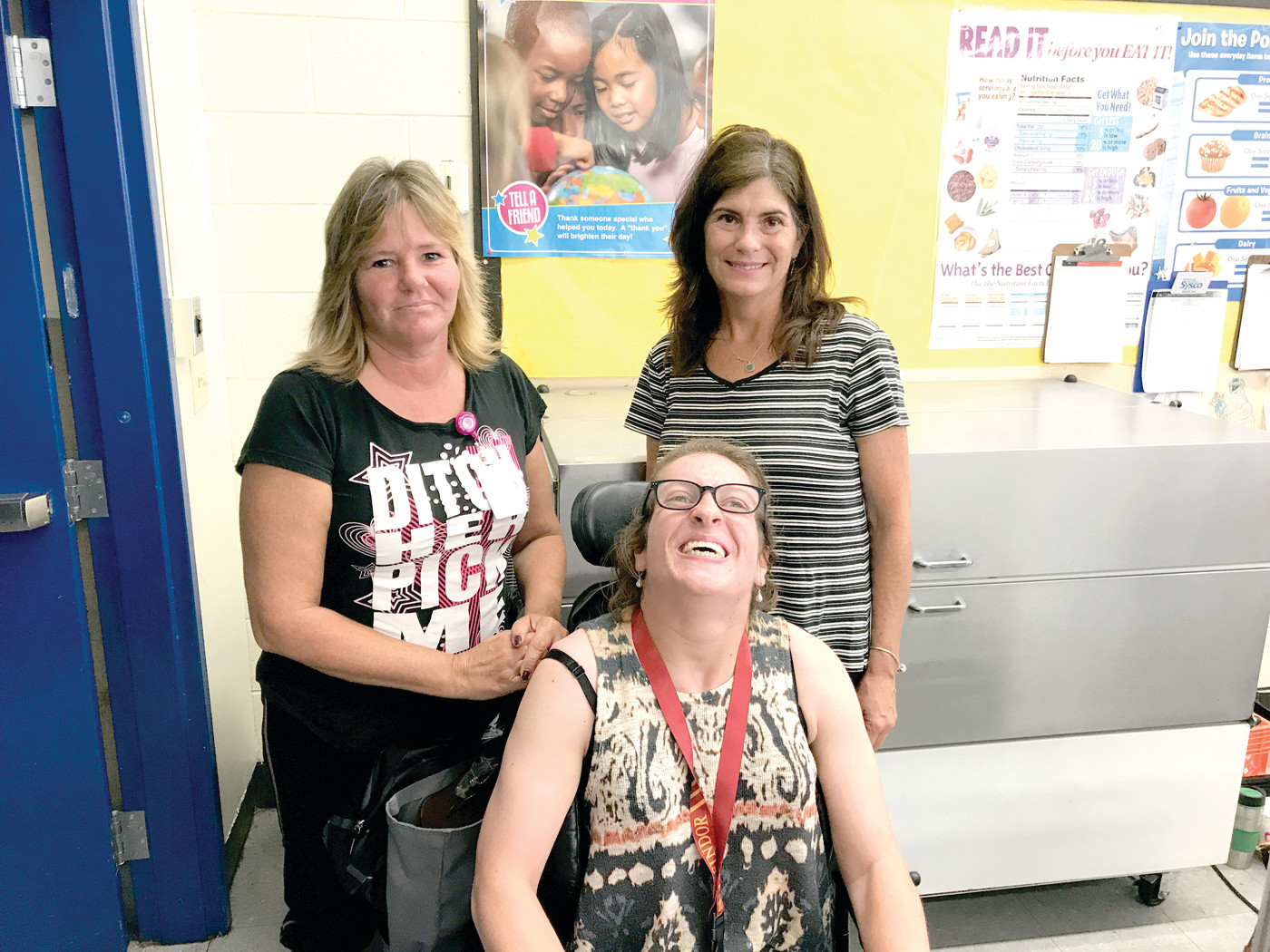 TEAMWORK MAKES THE DREAM WORK: Wickes staff Gail Champagne, Katie McAuslin and Paula Pugh take a break after handing out lunches.