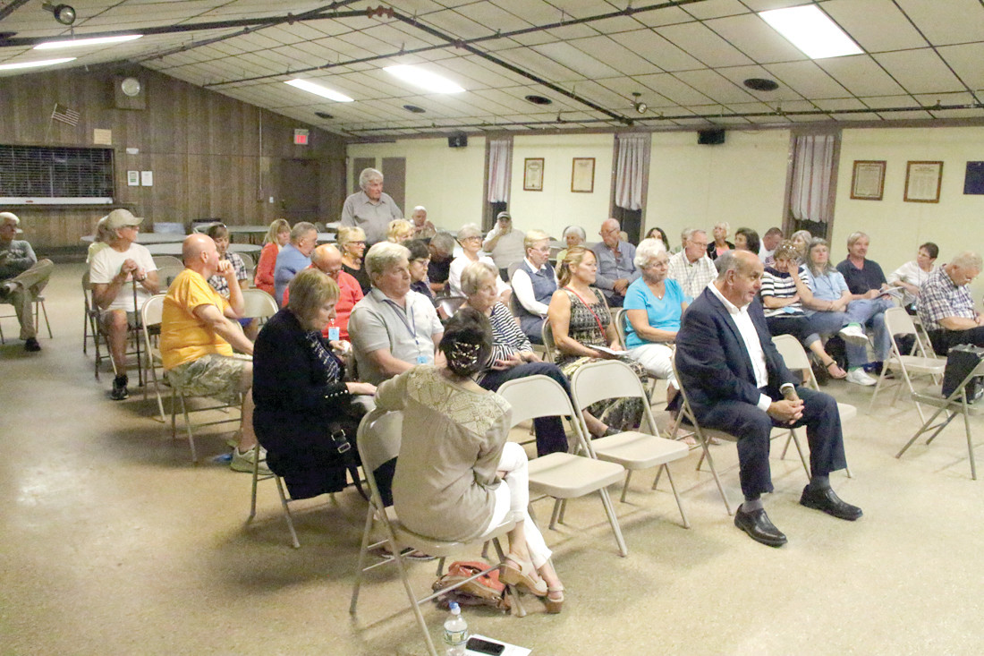 ATTENTIVE AUDIENCE: There was a strong turnout with plenty of questions for the mayor's Town Meeting hosted by the Conimicut Village Associations. STRAIGHT AWAY: Conimicut residents are concerned about speeding on Point Avenue.