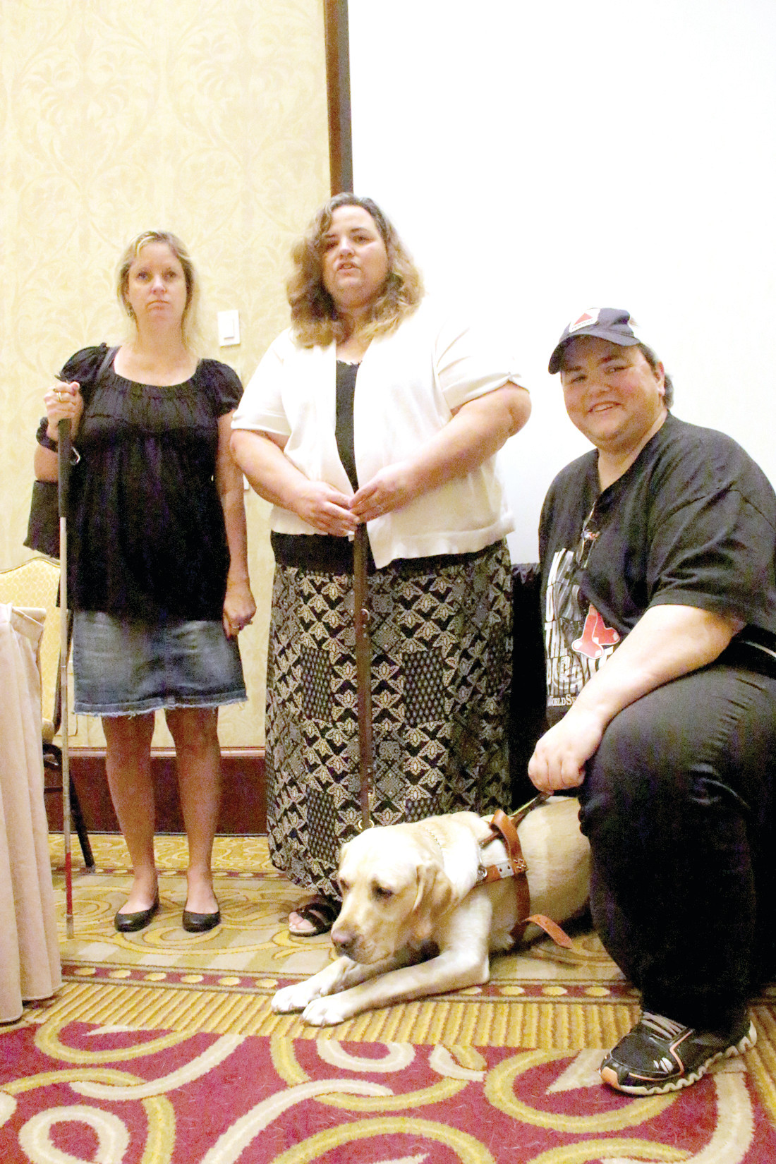 CONSIDERING A DOG: Keri Brent (left), who is legally blind, talks with Heather Schey and her twin sister Jeri about the responsibilities of a guide dog. Schey, a Warwick resident and the information and outreach coordinator at OSCIL, was born with retinitis pigmentosa and has been visually impaired since birth.