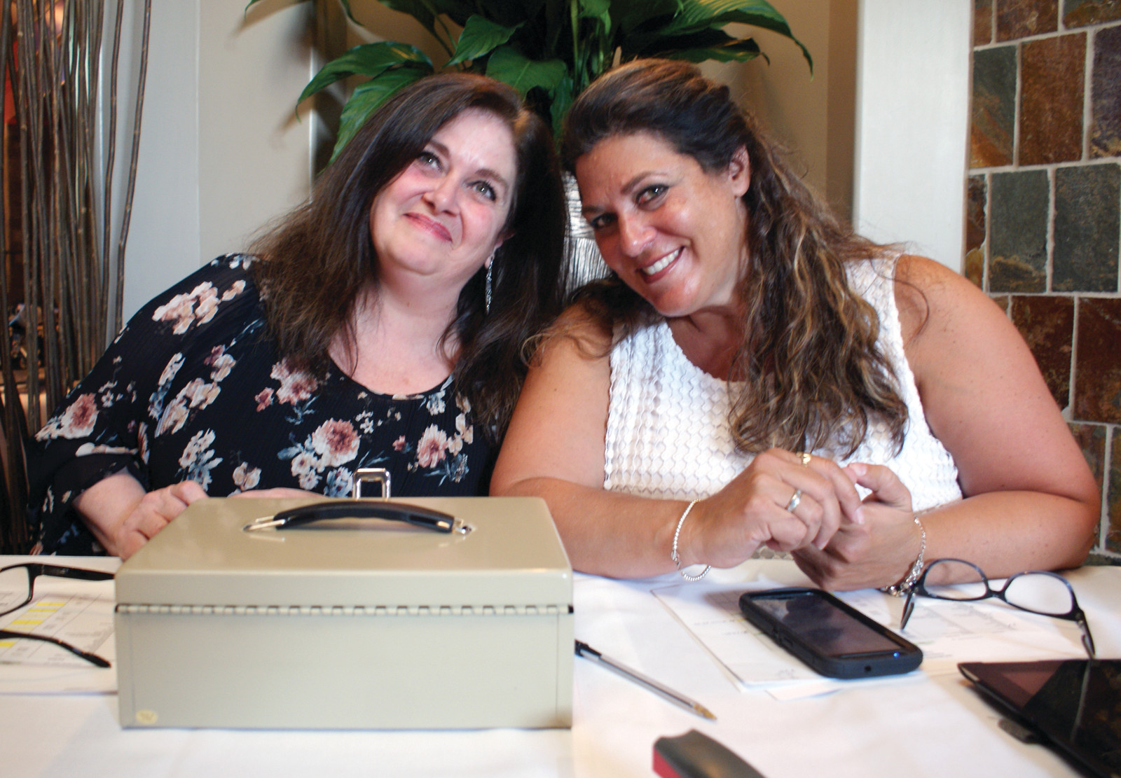 AT THE DOOR: Greeting guests to the Eric Medeiros Memorial Foundation at Spain Restaurant in Cranston were Joanne Marzilli and Maria Manzi, both from Cranston.