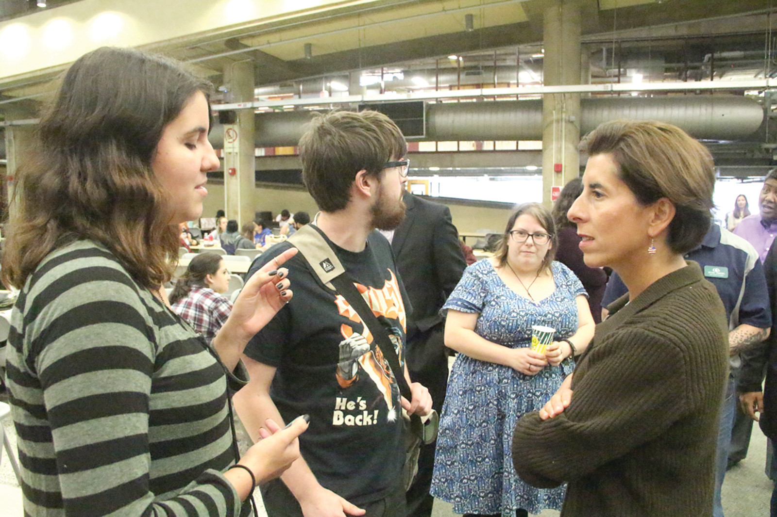 PROMISE FRESHMEN: CCRI freshmen Deryn Ordway and Alex Sylvester, who both are participating in the Promise Rhode Island Program, share their career plans with Governor Raimondo.