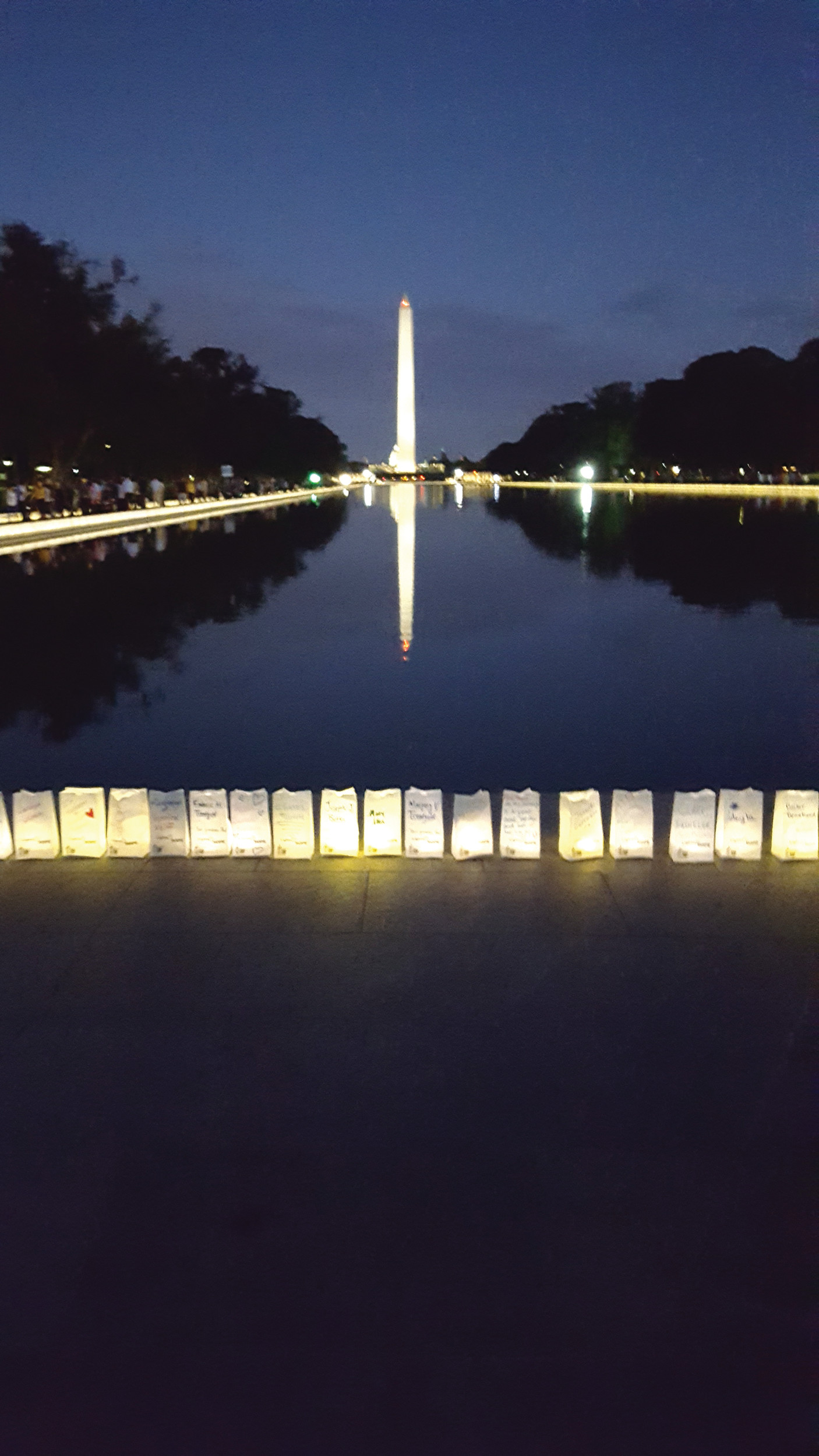 SHINING HOPE: More than 25,000 lined the reflecting pool in front of the Lincoln Memorial as part of the American Cancer Society lights of hope ceremony.
