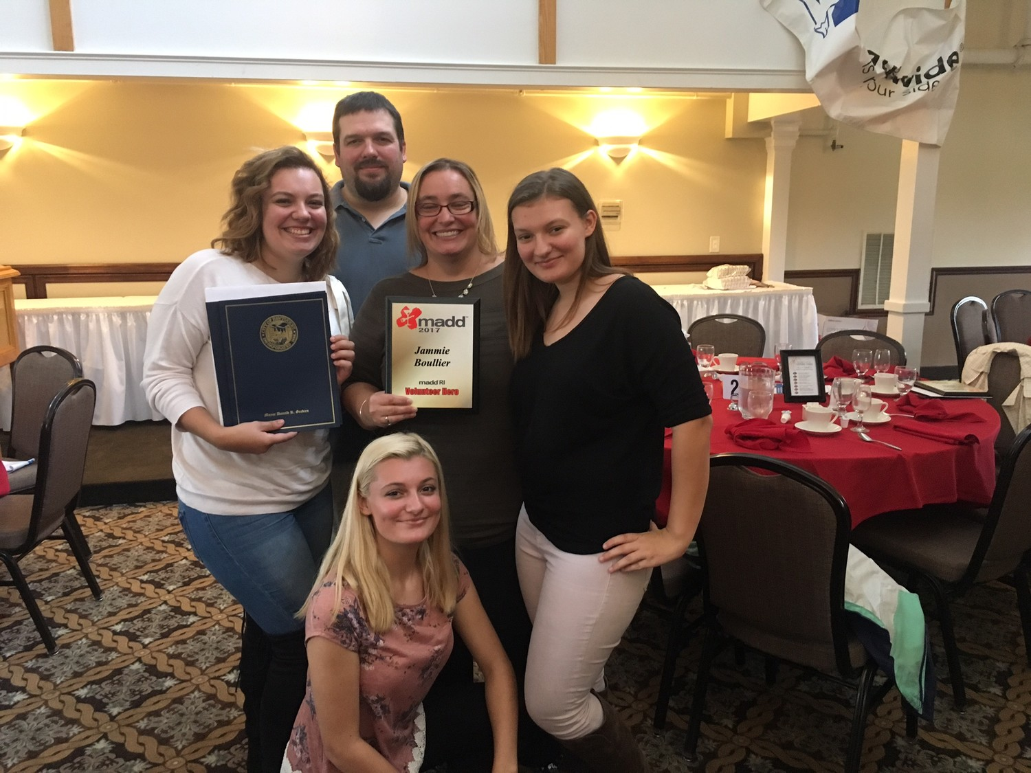 JAM AND FAM: Jammie Boullier was awarded the Volunteer Hero award for her vocal efforts to raise awareness about impaired driving. She is pictured with her daughters Kyra (left), Isabelle (kneeling) and Megan (right), as well as her husband, Mathew.