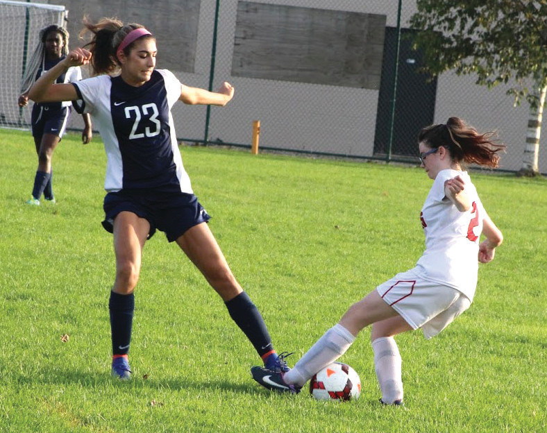 FORCE: Bianca Robbins wins a loose ball in the middle of the field on Monday.
