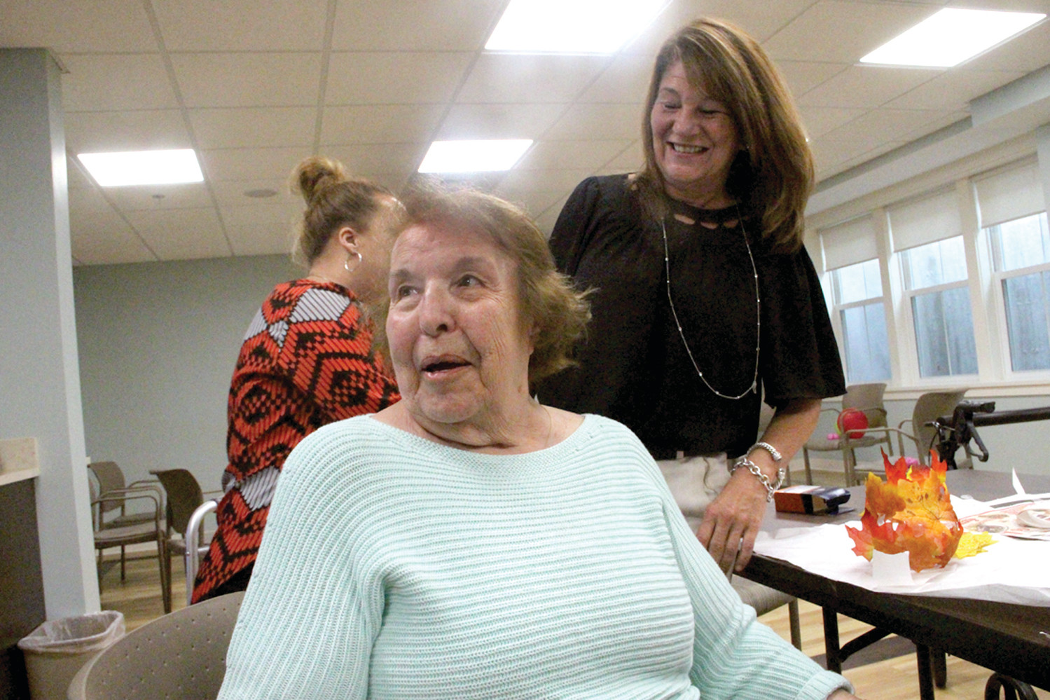 LOVES THE PEOPLE: Rose Johnson takes a break from a crafts project to join in the conversation. Looking on is Maureen McGhie, director of nurses at Brentwood Nursing Home.