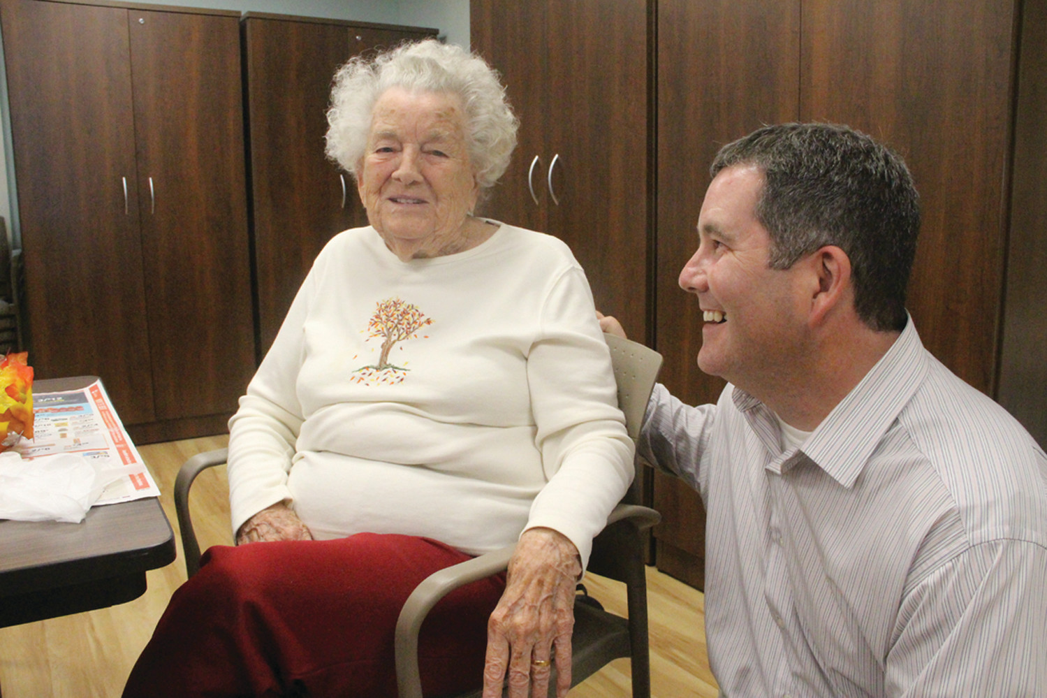 SHARING A LAUGH: Edna Leonard, one of the first residents at Brentwood, and Michael McMahon talk about life at the new assisted living facility.