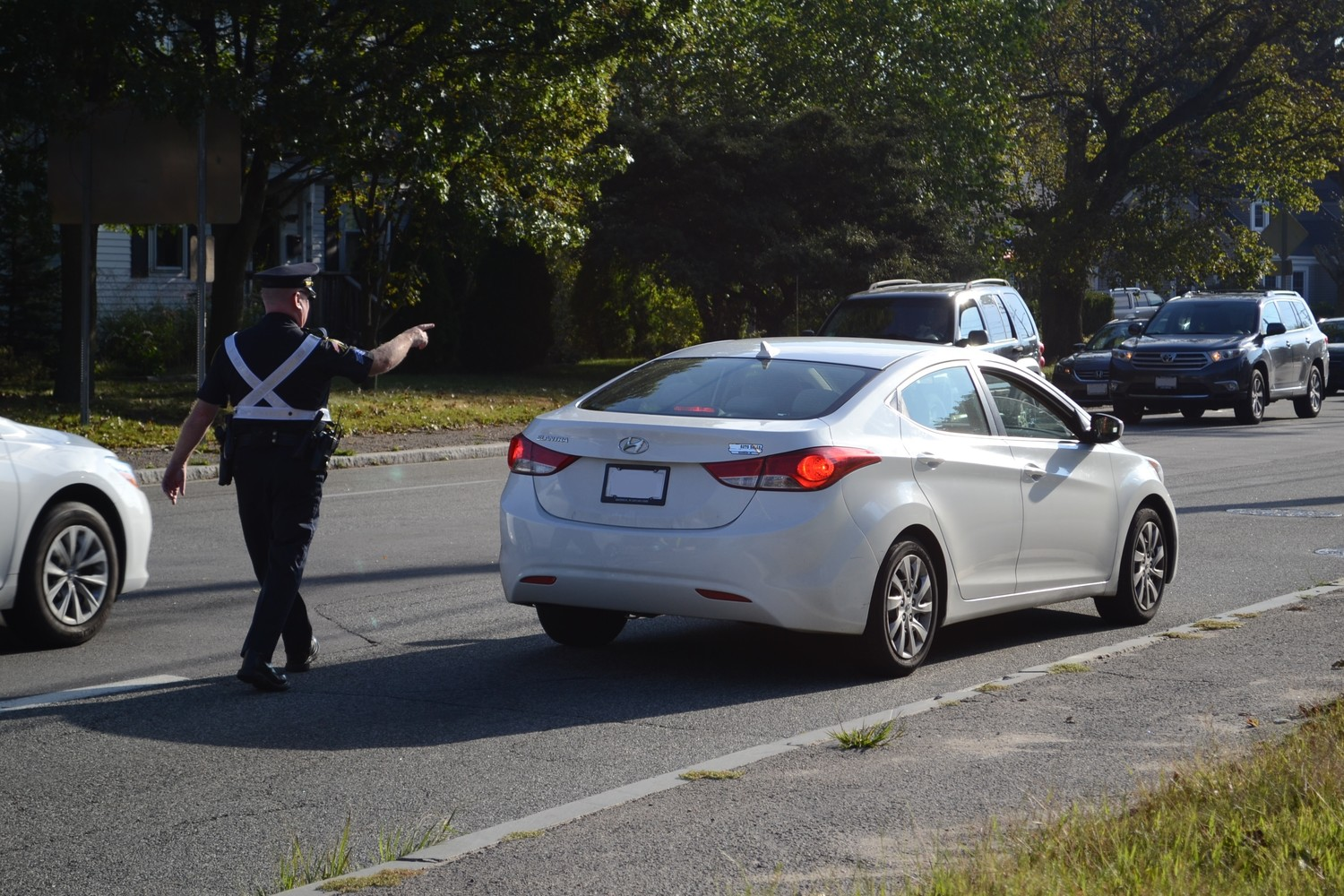NOT SO FAST: Sgt. John Kelly, who leads the Warwick Police Traffic Unit, pulls over a motorist who failed to stop at the crosswalk in order to give an educational talk on proper safety statutes.