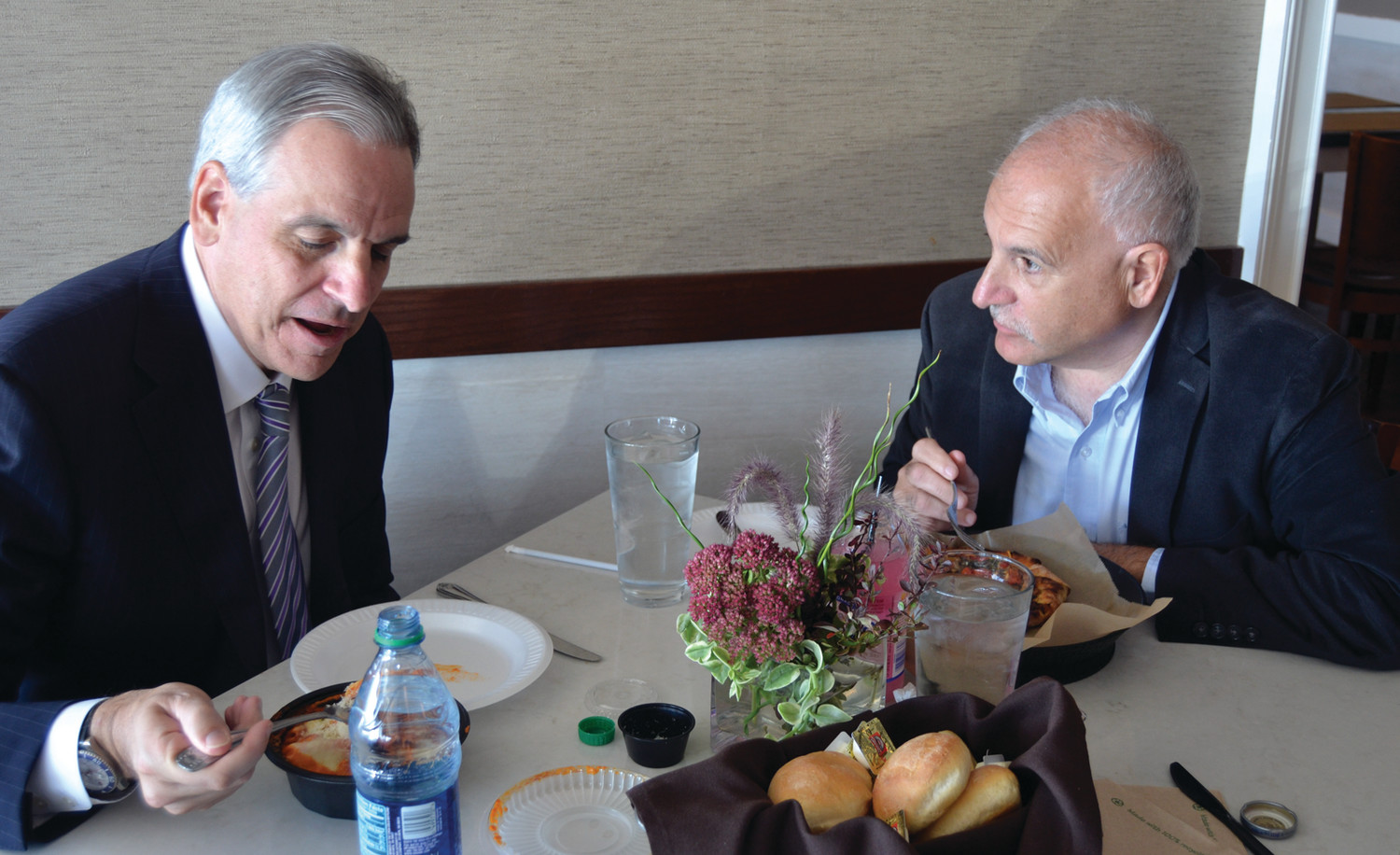 CAMPAIGN STOP: Former U.S. Attorney Peter Neronha and Johnston Mayor Joseph Polisena enjoy lunch at Luigi's during Neronha's first campaign stop.