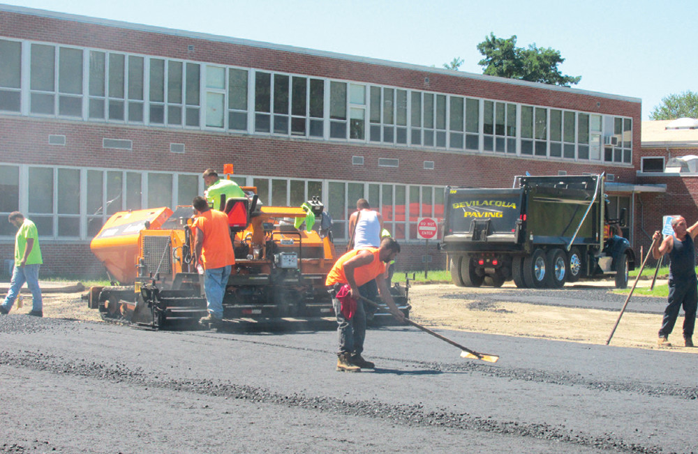 IMPROVEMENTS NEEDED: Work crews recently installed new paving alongside Ferri Middle School. A recent statewide report showed that the Johnston School District needs more than $53 million in repairs to bring it into the 21st century.