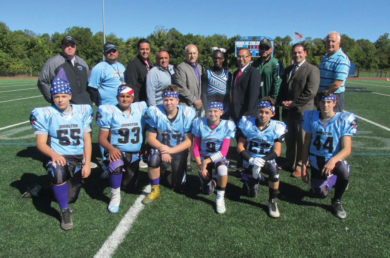 MEMORIAL MOMENT: Among those Johnston Youth Football League and CLCF officials who took part in Sunday's special tribute and fundraising effort that will benefit the Jaxon Marocco Foundation, are kneeling in front from left: Nicholas Keller, Alexander Morin, Michael Laflamme, Dante Iafrate, Micheal Salzillo and Nicholas Baccala. Top row: Matt Clements, Phil Morin, Robert Russo, Gary Salzillo, Mayor Joseph Polisena, Taylor Powell, Mayor Allan Fung, Bryan Stetson, Robert Nardolillo and David Cournoyer.