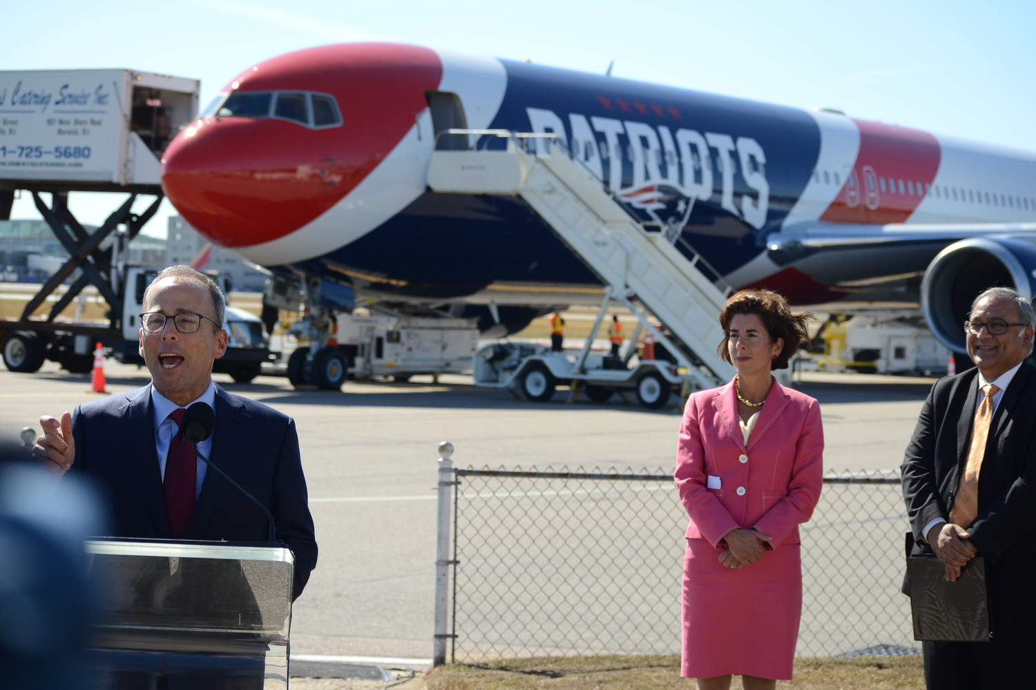 A PRO PARTNERSHIP: Patriots president Jonathan Kraft speaks at the inaugural sendoff for the new Patriots plane at TF Green Airport, with the plane, Governor Gina Raimondo and Rhode Island Airport Corporation CEO and president, Iftikhar Ahmad, in the background.
