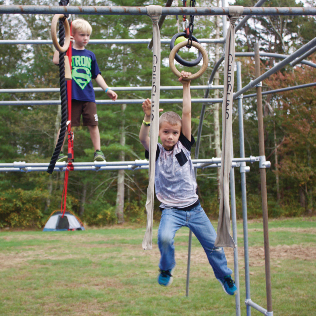 WATCHFUL EYE: Max Skinner, 7, watches as CJ Jardin, 7, of Warwick practices his ninja skills at ObstaCamp.