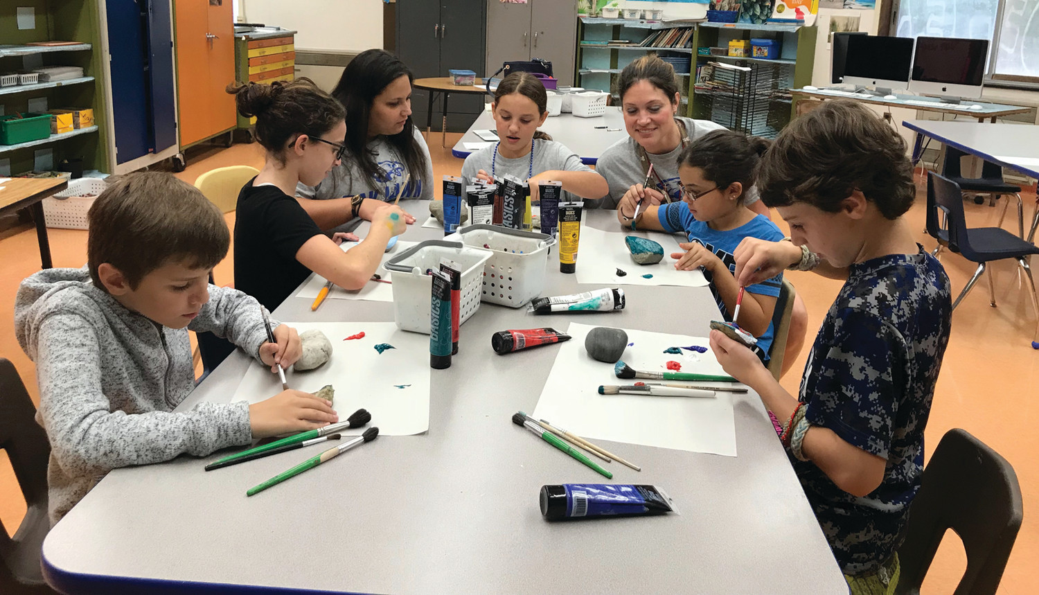 ROCKIN' ON: Students in Mrs. Mancuso's grade 5 classroom work on their community rock project. L-R, Jonah Silva, Francesca Paola, Mancuso, Avery Ashegh, Iacovone, Ava Silveira and Harry Coupe.