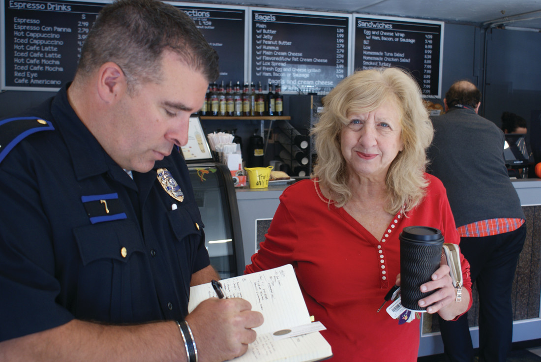 ONE ON ONE: Oaklawn Ave. resident, Domenic Scotti, spoke to Capt. Vincent McAteer during Coffee with a Cop held at Café International on Oaklawn Ave.