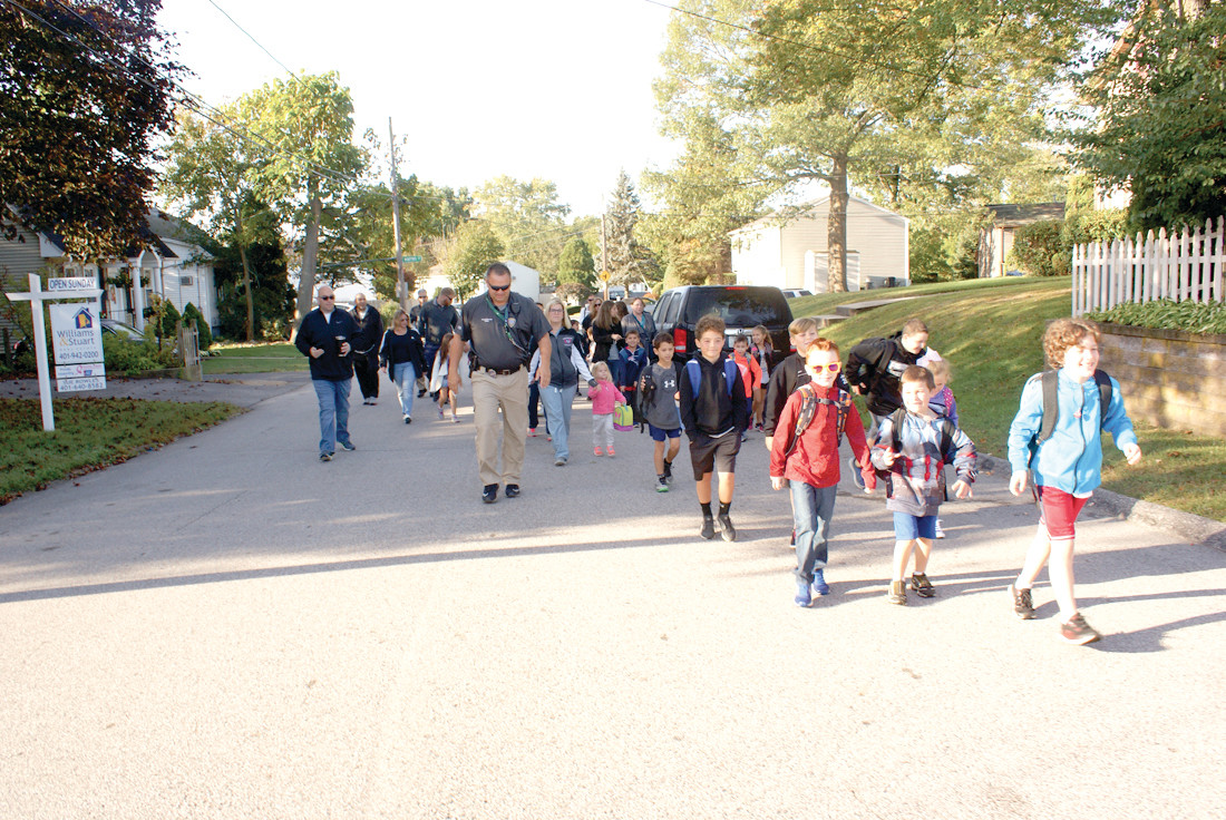 HEALTHY AND HAPPY: Students, parents and Cranston Police School Resource Officers (SROs) are pictured along their walk to Oaklawn Elementary School on Oct. 4.
