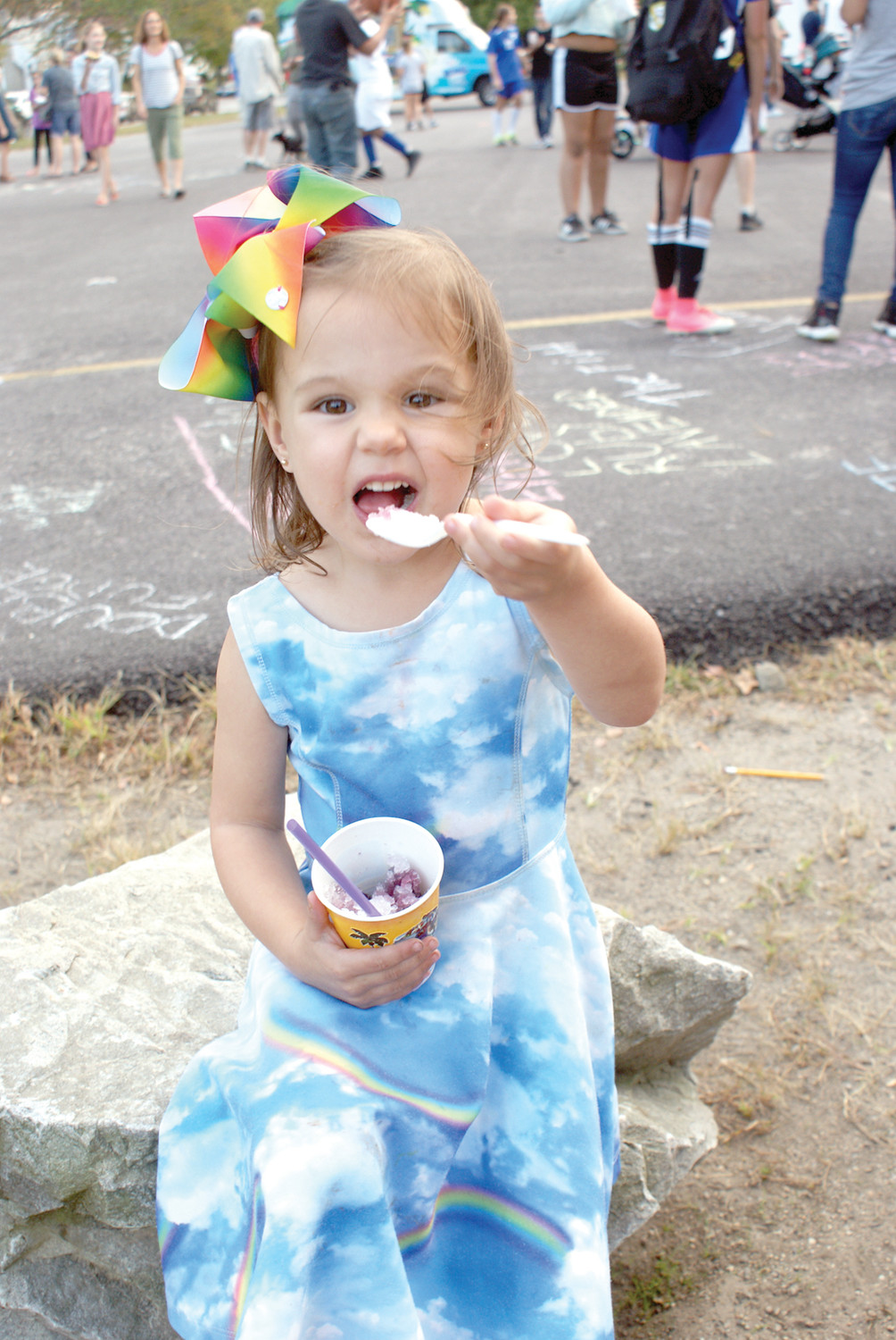 HOW SWEET IT IS: Young Celia DeFelice, age 3, of Cranston is pictured enjoying her Kona Ice at the Park View Middle School Food Truck Night on Oct. 5.
