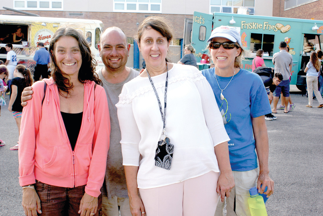 EVENT ORGANIZERS: Pictured are (l-r) Lisa Gibb (PTPV treasurer), Brian Deluca (PTPV co-president), Kerrylin Reagan (PV assistant principal) and Wenly Ferguson (PTPV member), who all helped to organize the second annual Food Truck Night at Park View Middle School.